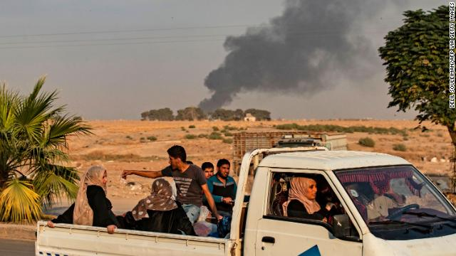 Civilians flee in a truck amid Turkish bombardment on Syria's northeastern town of Ras al-Ain, along the Turkish border.