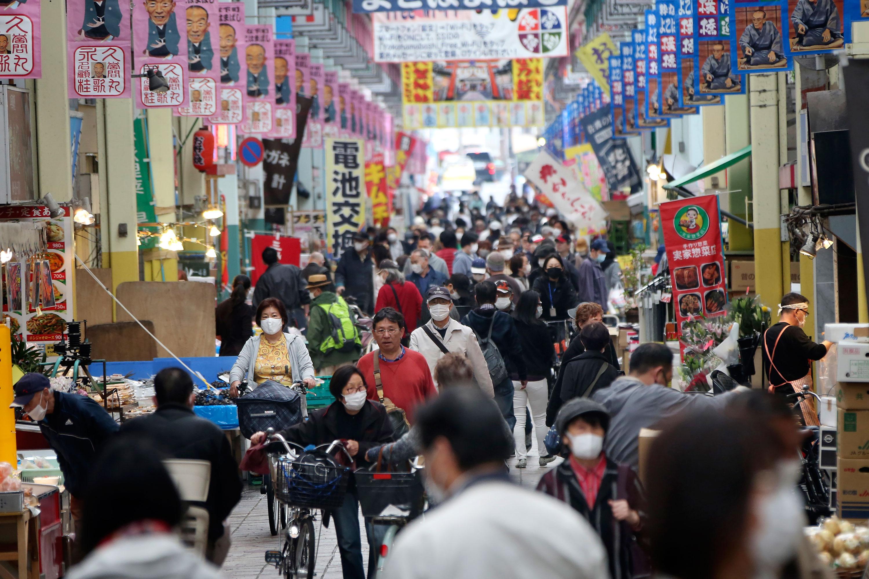 People walk through a shopping area in Yokohama, near Tokyo, on April 27.