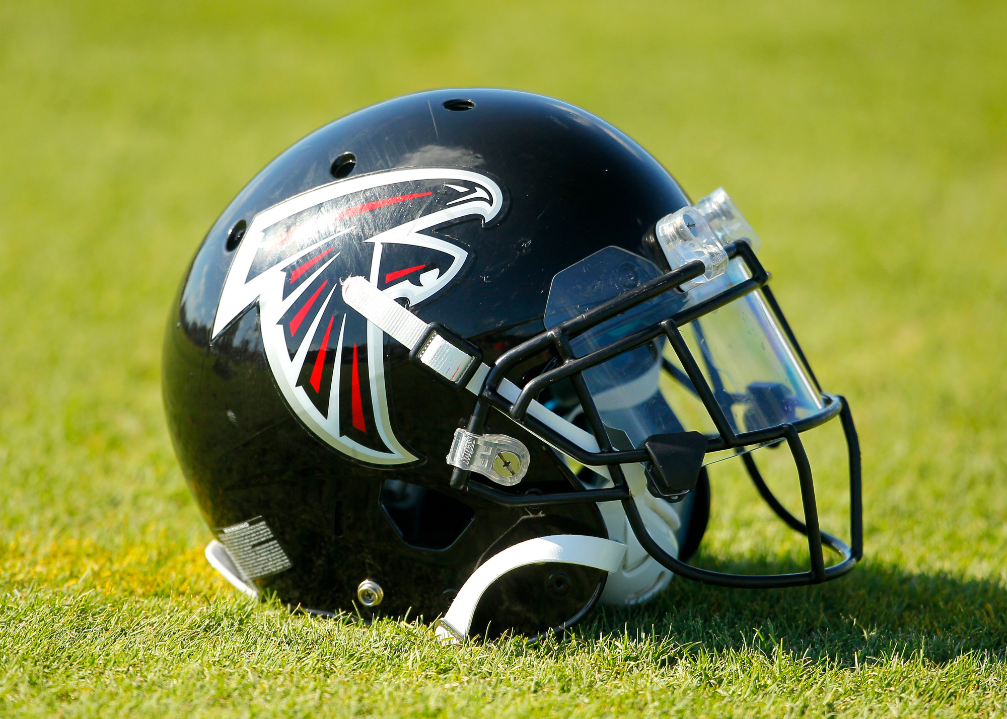An Atlanta Falcons helmet sits on the field during training camp at Falcons headquarters in Flowery Branch, Georgia, on July 28, 2014.