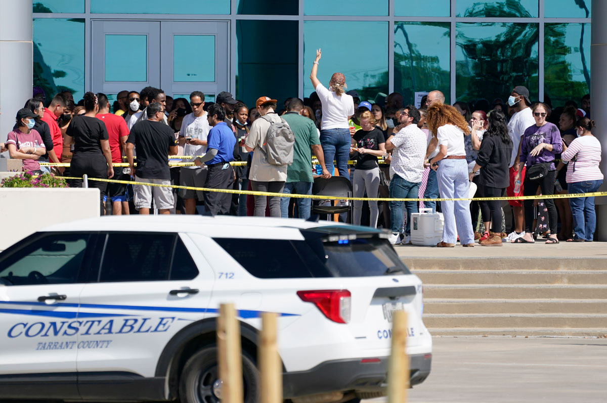 Families wait to be reunited with their children at the Mansfield ISD Center For The Performing Arts, where students of Timberview High School were taken following a school shooting.