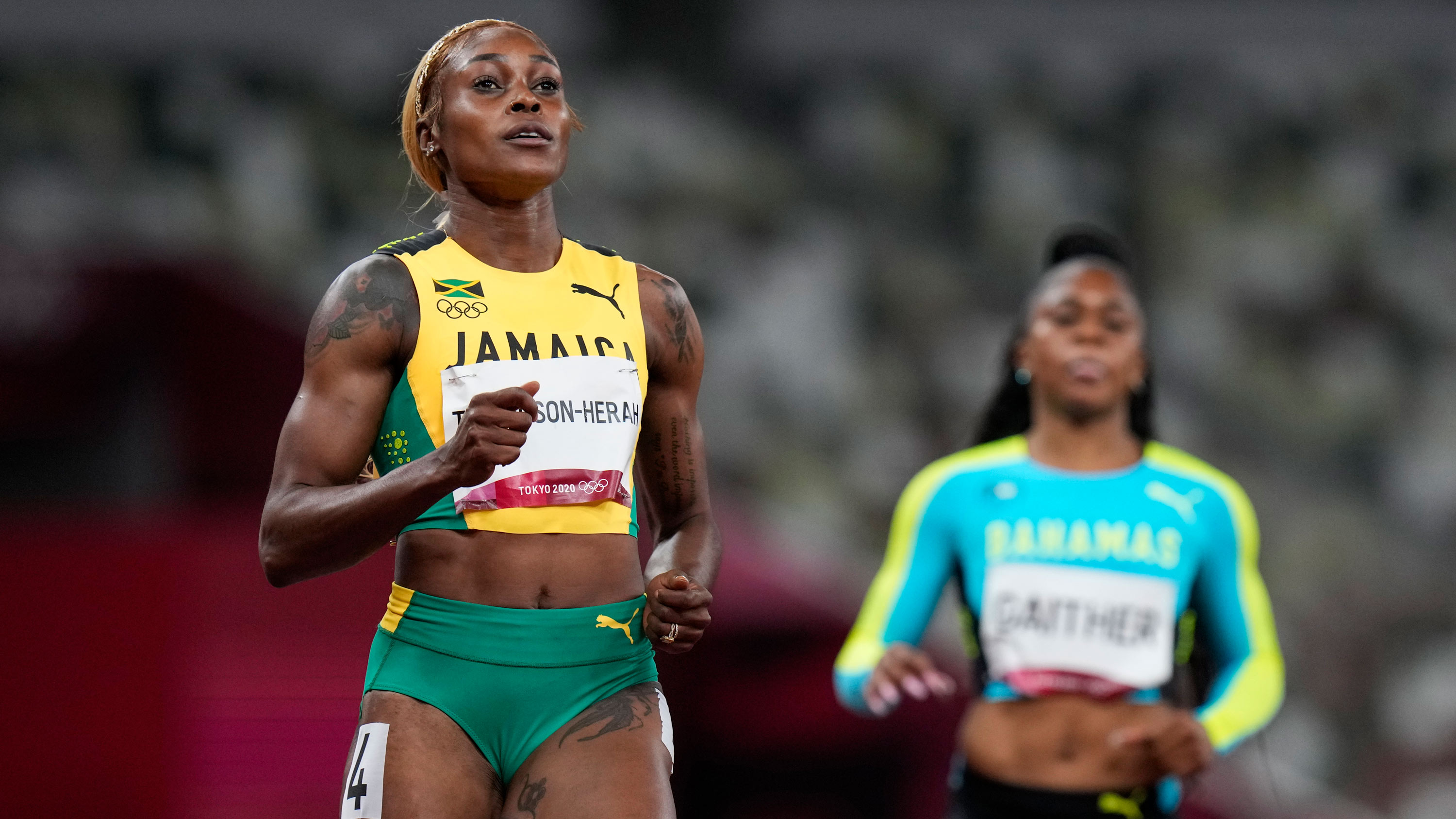Defending Olympic 100m champion Elaine Thompson-Herah of Jamaica wins her 100m semifinal on July 31.