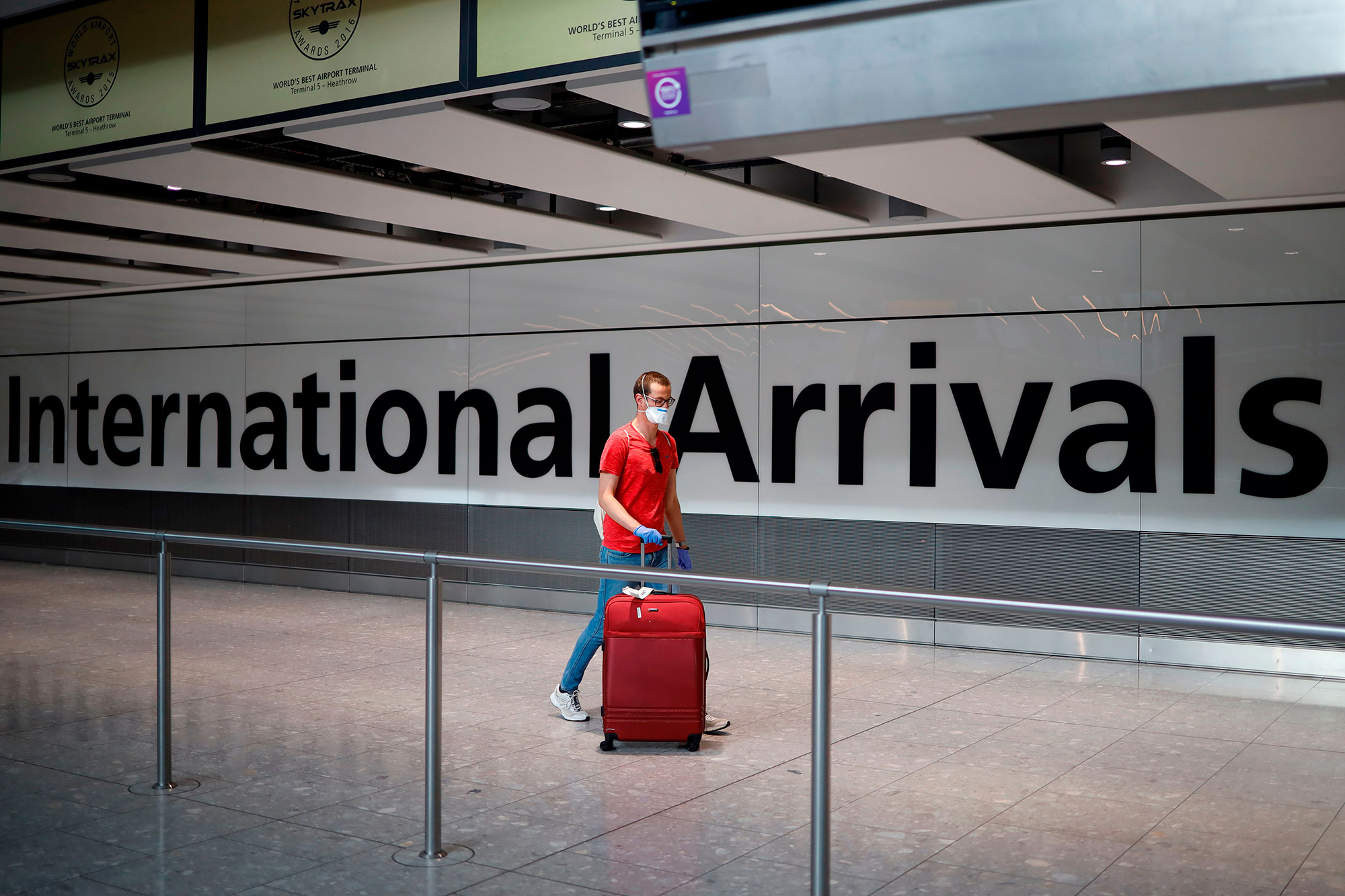 A passenger walks through Heathrow Airport in London on May 22.