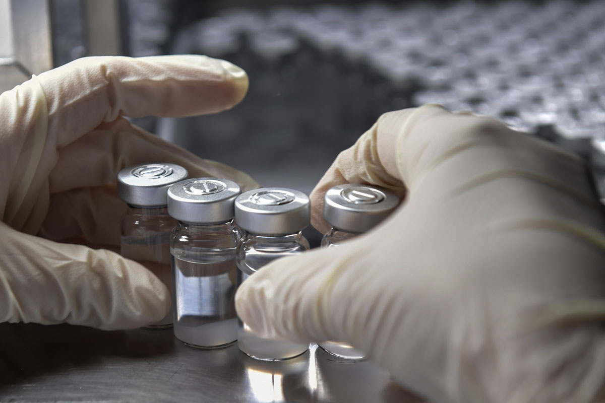 An employee works on the production line of CoronaVac, Sinovac Biotech's vaccine against Covid-19, at the Butantan biomedical production center in Sao Paulo, Brazil, on January 14.