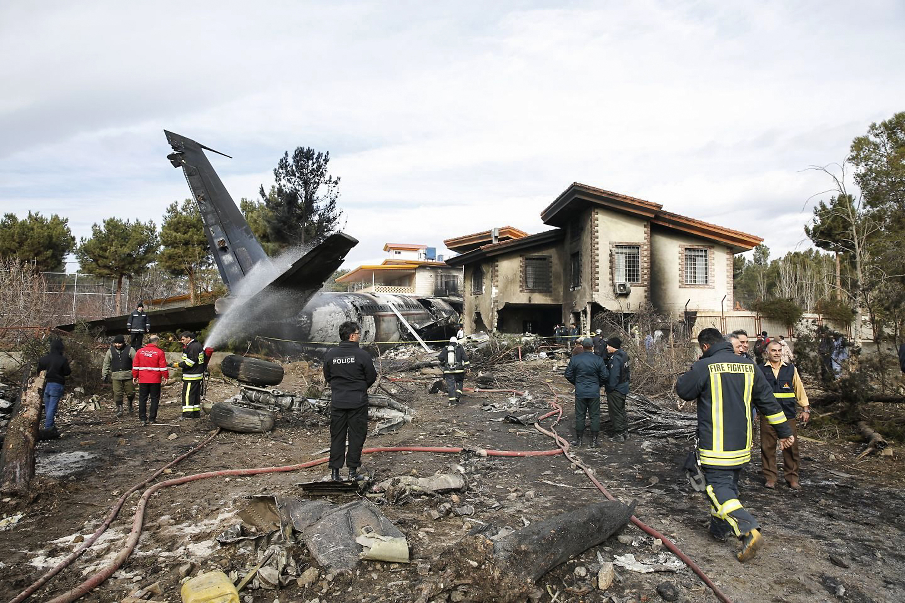 The debris of a Boeing cargo plane that crashed near Tehran on January 14, 2019.