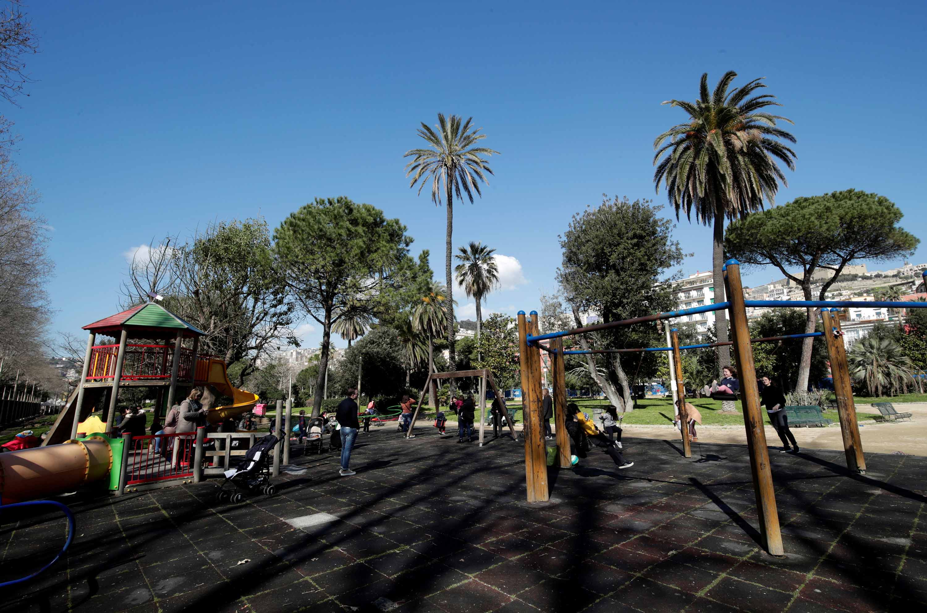 Children play in a park after the Italian government declared the closure ofschools in Naples,Italy, on Thursday.