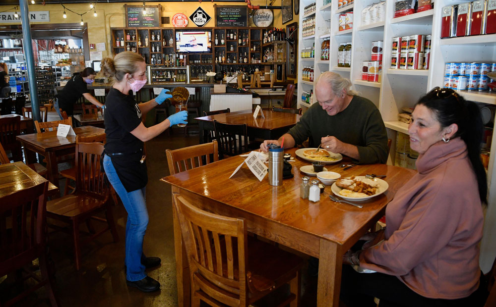 Lee and Johnny Laing enjoy having a meal inside Puckett's on Monday, April 27, in Williamson County, Tennesee. Puckett's opened on Monday at 50% capacity.