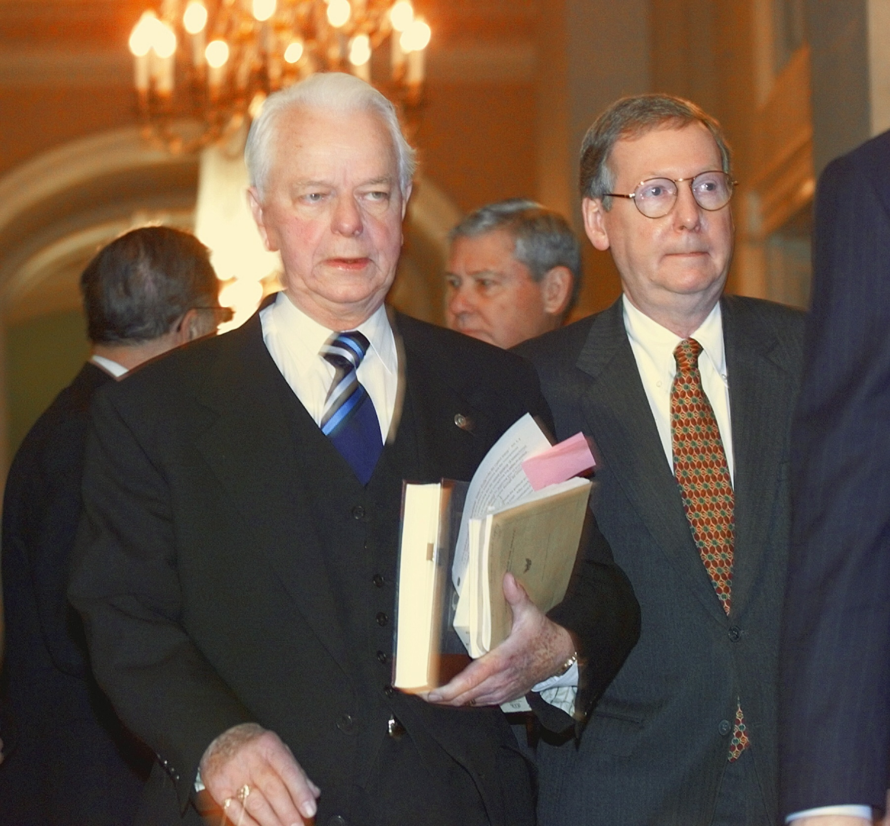 Sen. Mitch McConnell (right) attends at 1999 caucus to possibly establish rules and guidelines for the impeachment trial of US President Bill Clinton.