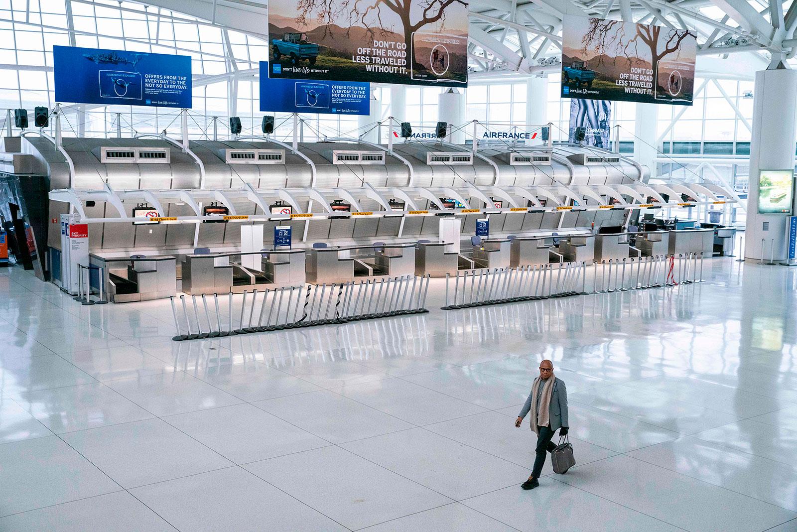 A man walks through Terminal 1 at John F. Kennedy International Airport on March 12.
