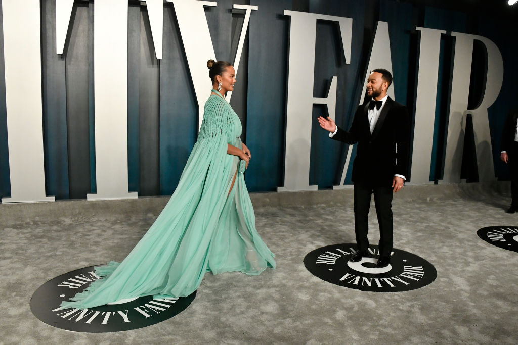Chrissy Teigen and John Legend attend the 2020 Vanity Fair Oscar Party hosted by Radhika Jones at Wallis Annenberg Center for the Performing Arts in Beverly Hills, California.