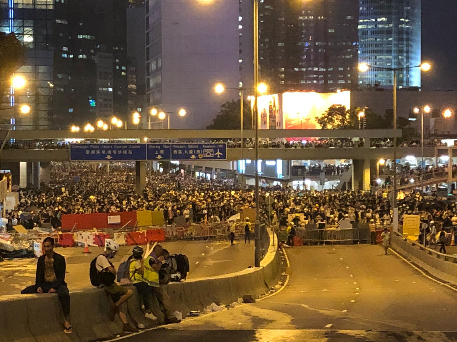 Protesters gather on Harcourt Road in front of City Hall.