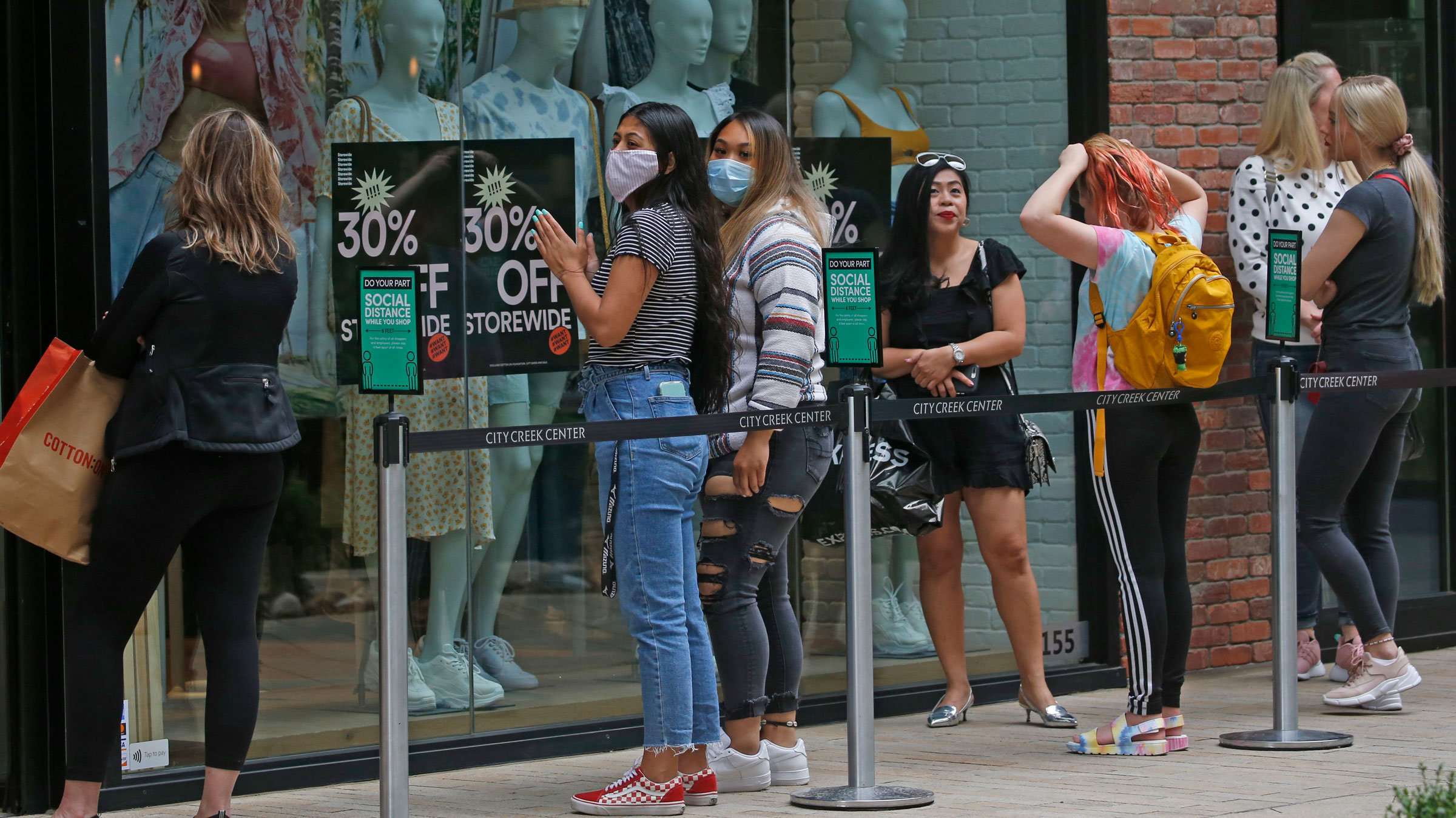 People wait in line in front of a store in Salt Lake City on May 22.