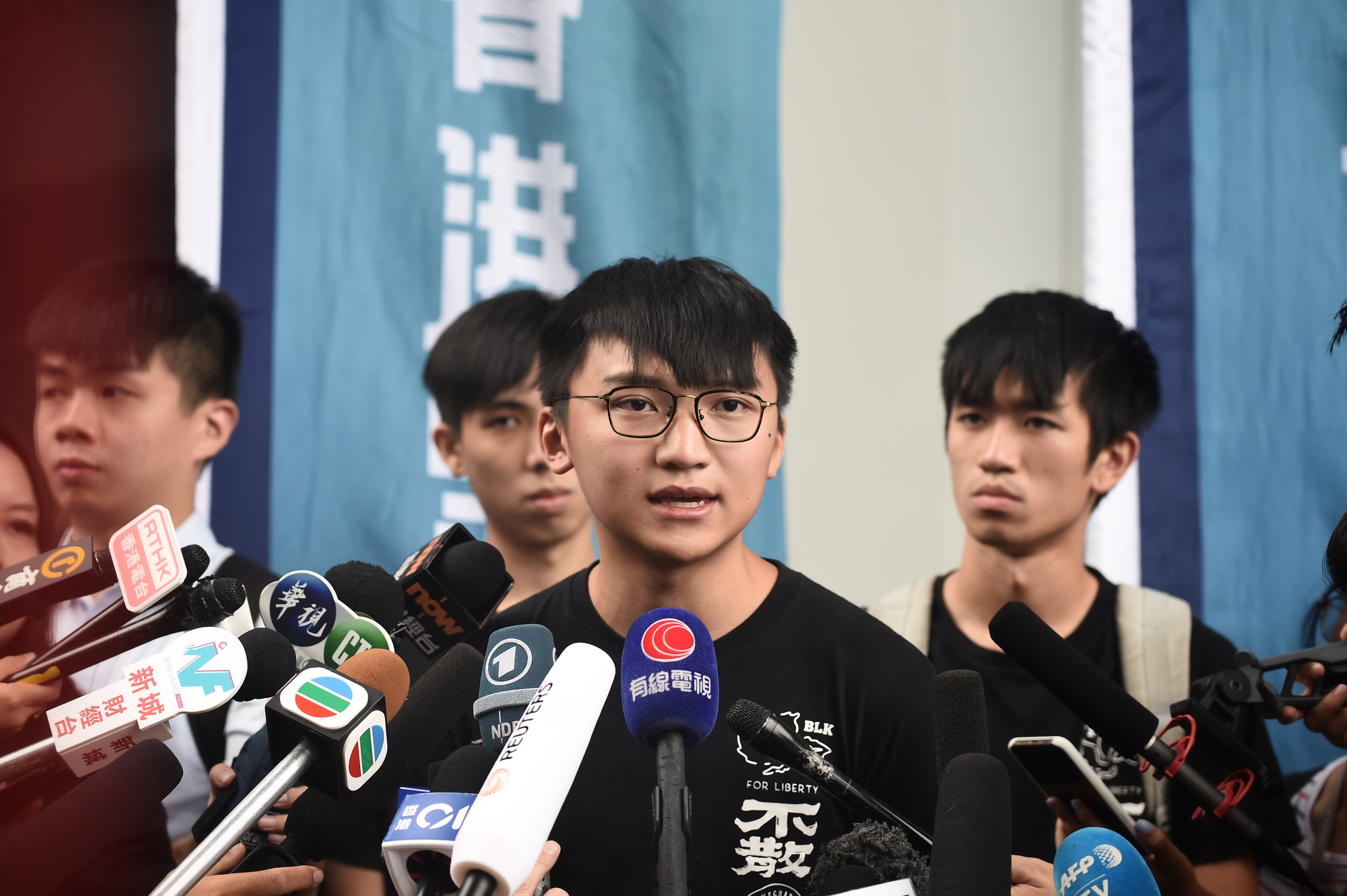 Demosisto Vice Chairperson Isaac Cheng speaks to press on the arrest of party leaders Joshua Wong and Agnes Chow, in Hong Kong on August 30, 2019.