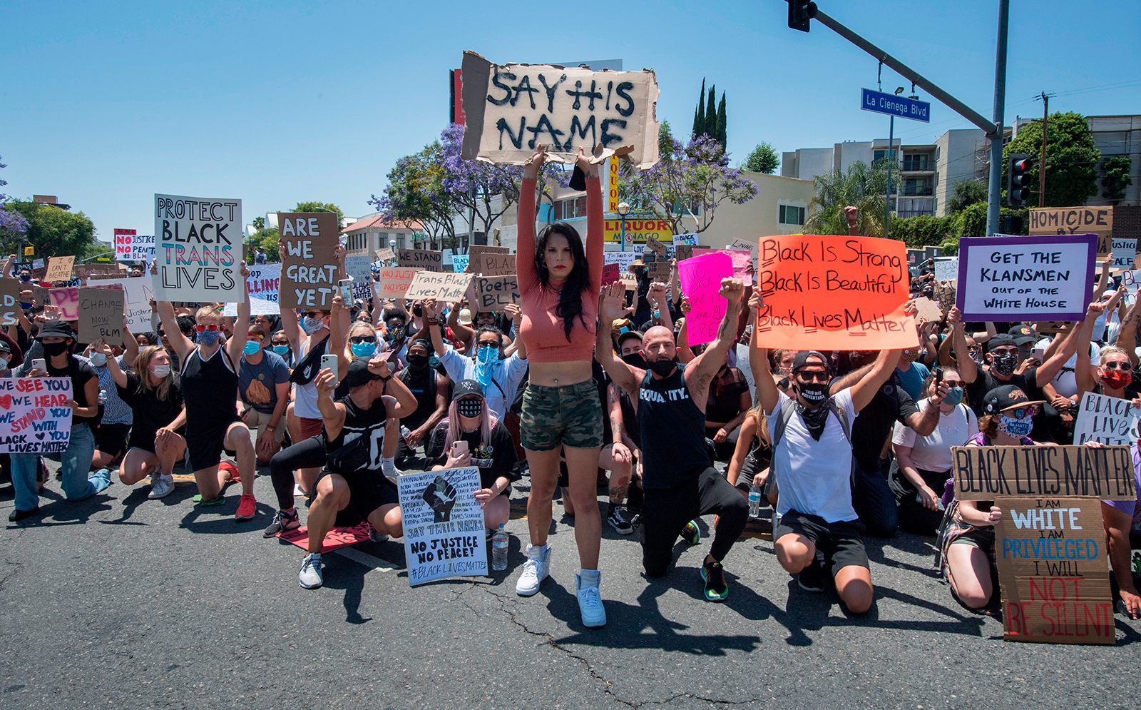Demonstrators march as they protest the death of George Floyd, in West Hollywood, California on June 3.