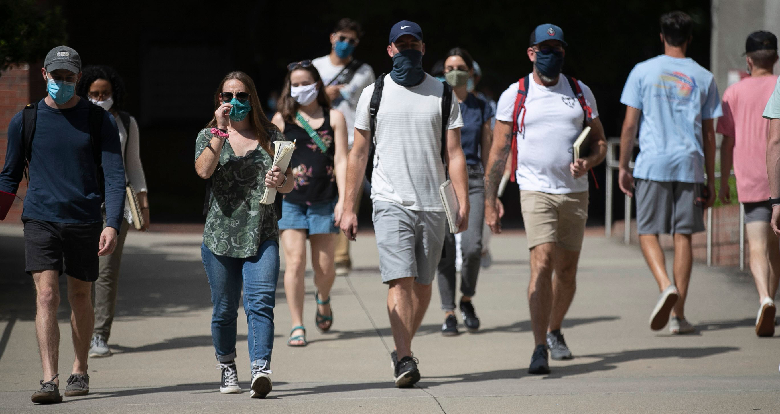 North Carolina State University students walk through campus on August 18 in Raleigh, North Carolina.