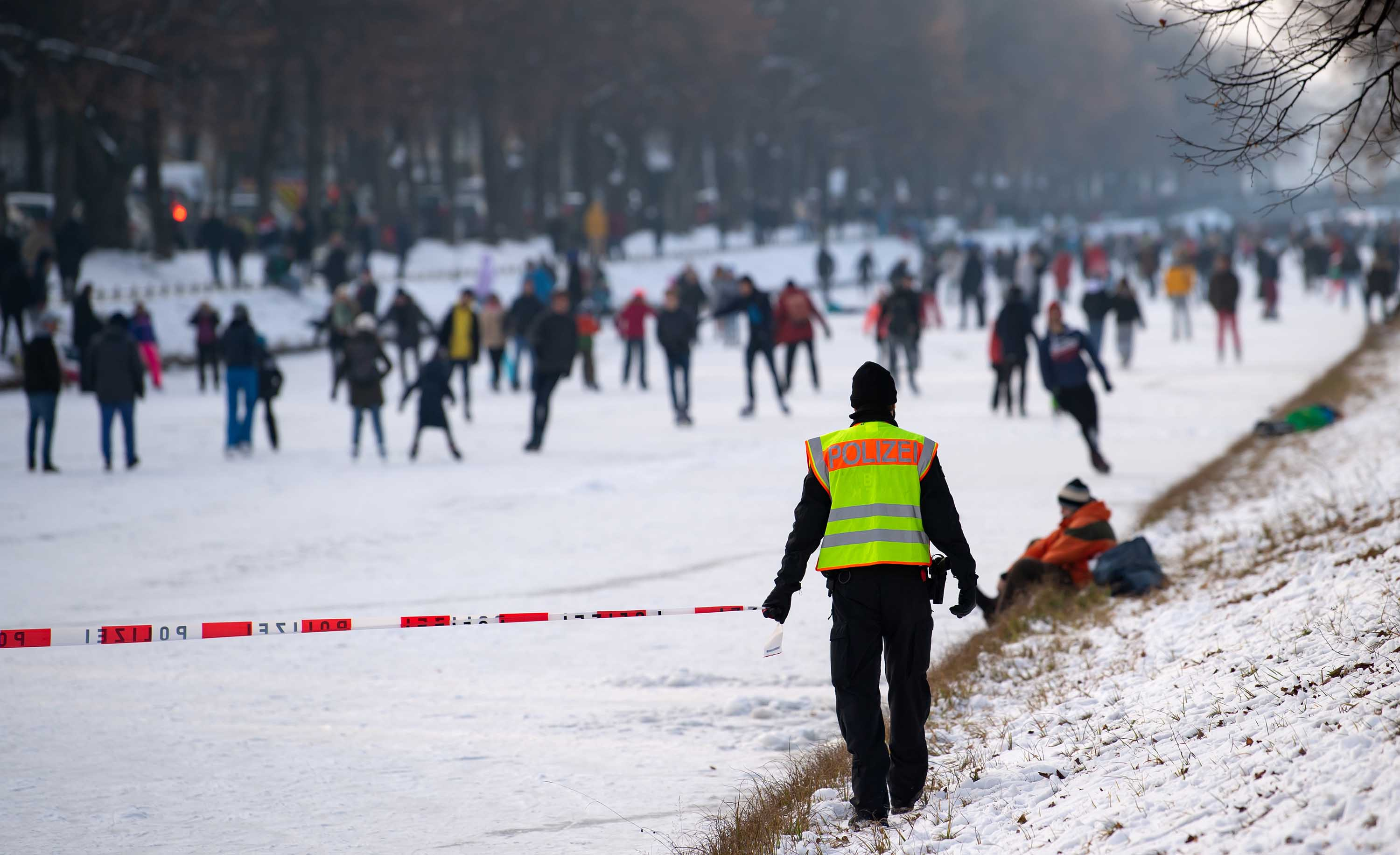 Police officers clear the Nymphenburg Canal in Munich, Germany, on Sunday.