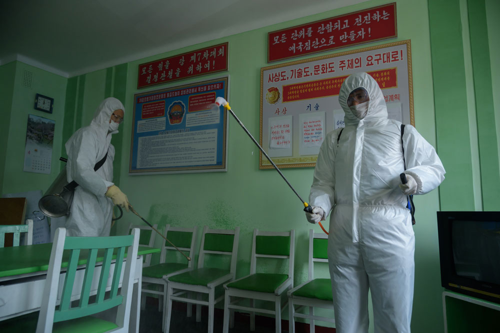 Health officials disinfect an office room amid concerns over the coronavirus at the Pyongchon District People's Hospital in Pyongyang on April 1.
