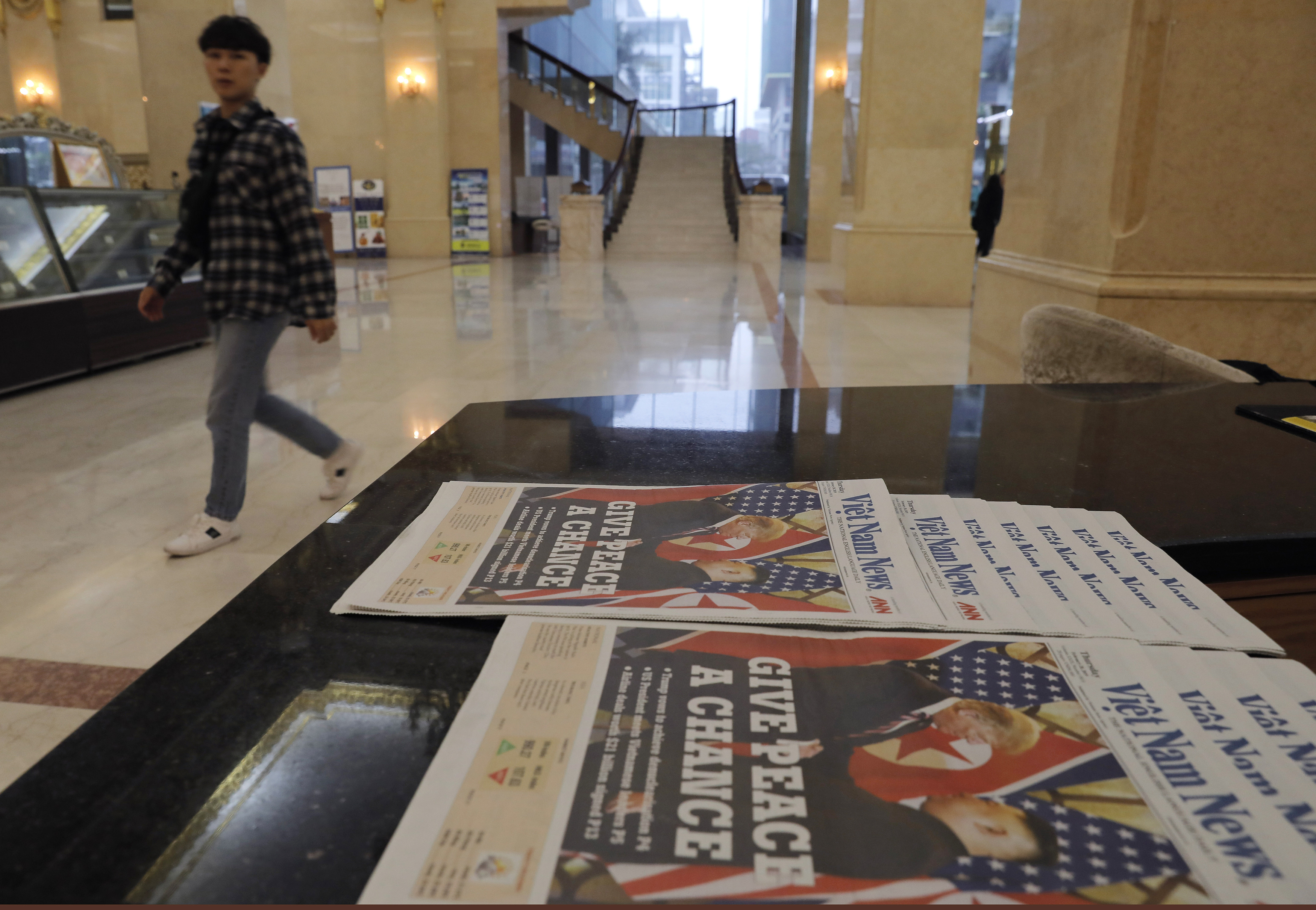 Newspapers on display in a Hanoi hotel on Thursday morning.