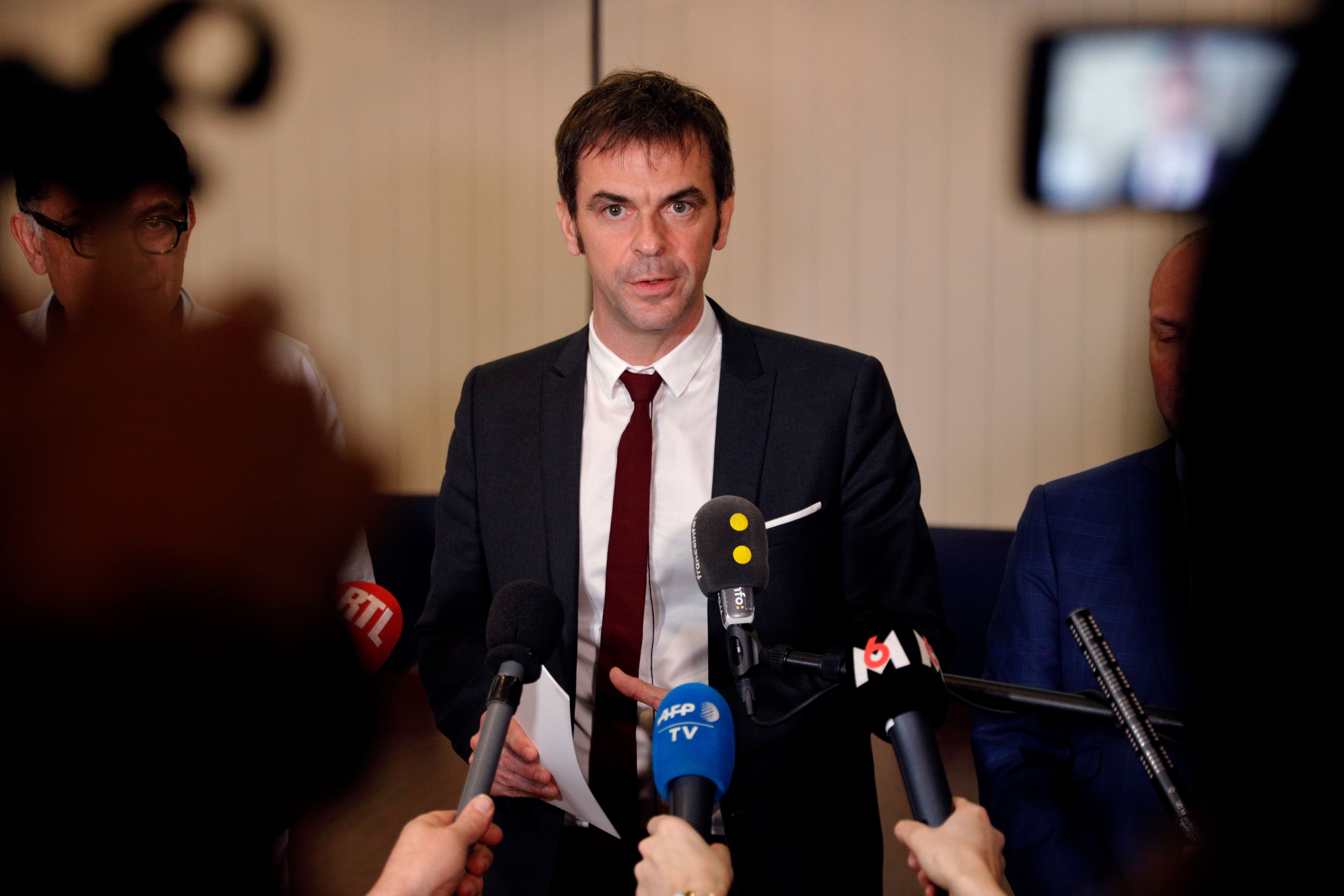 French Health and Solidarity Minister Olivier Veran addresses media during a news briefing on the coronavirus.