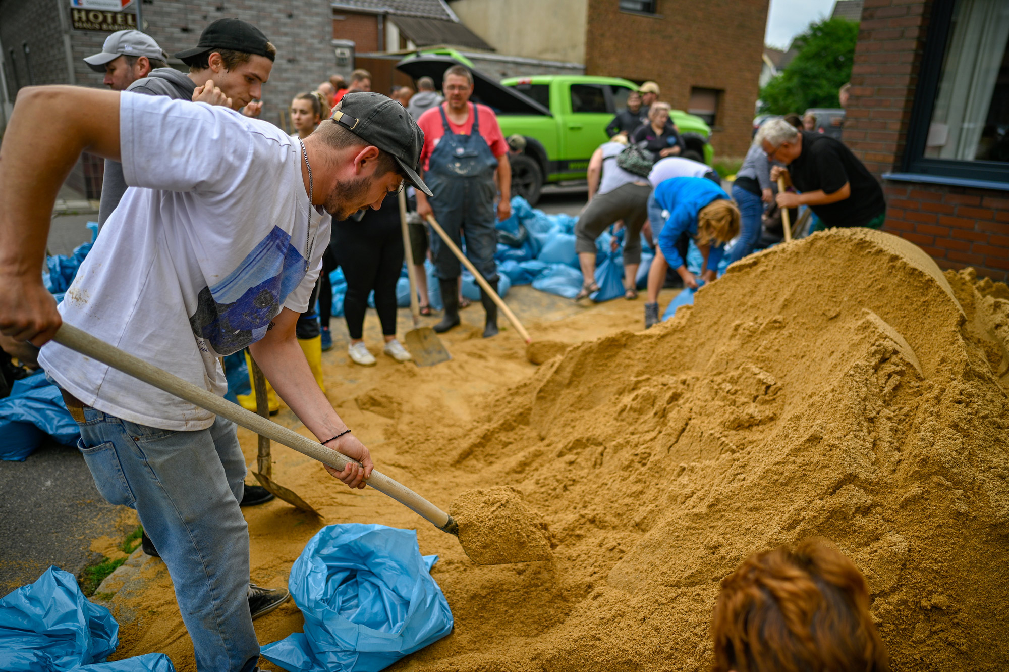 Residents fill bags with sand to protect against flooding on July 16 in Erftstadt, Germany.