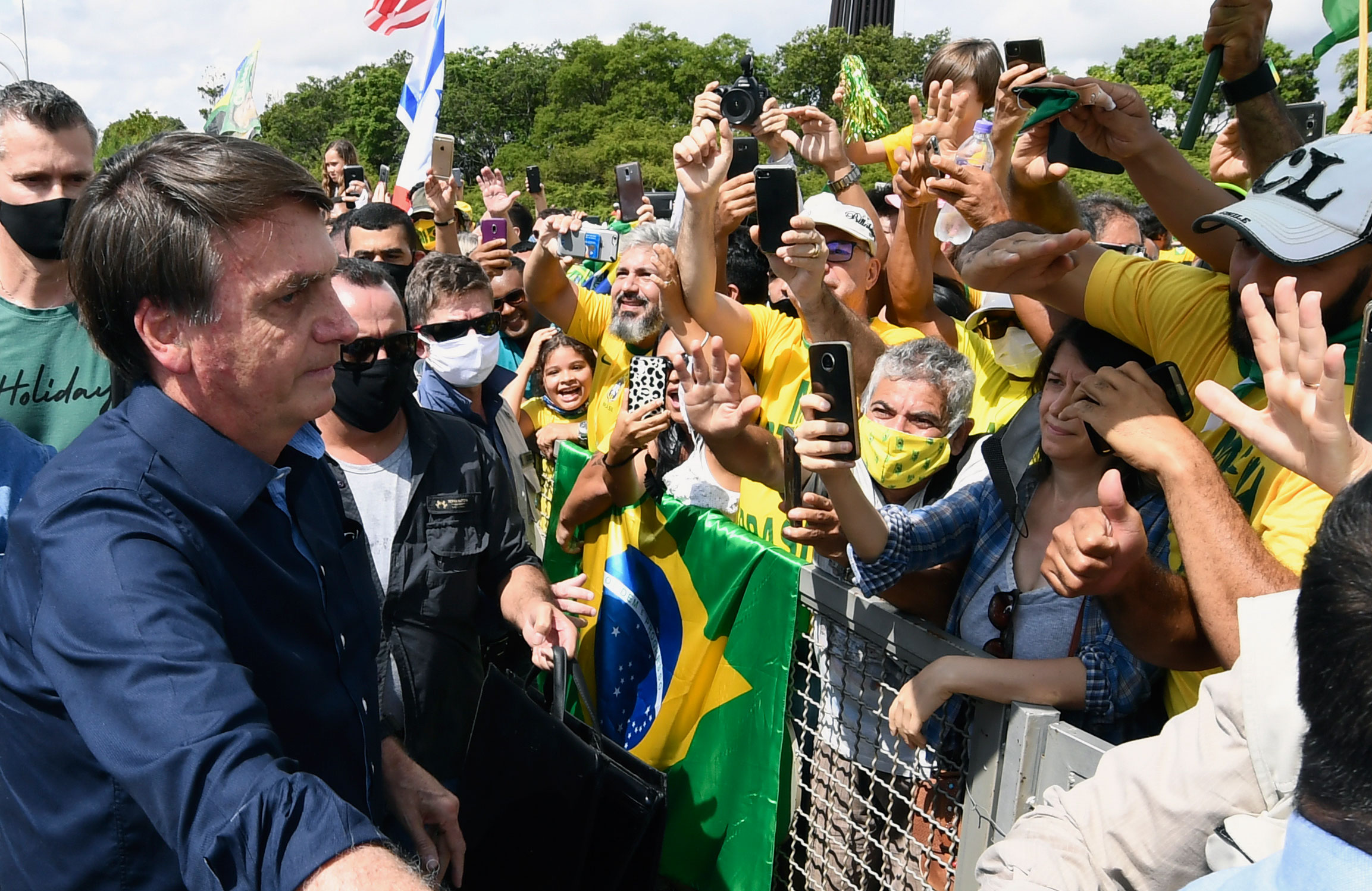 Brazil's President Jair Bolsonaro interacts with the crowd at Planalto Palace in Brasilia, on May 24.