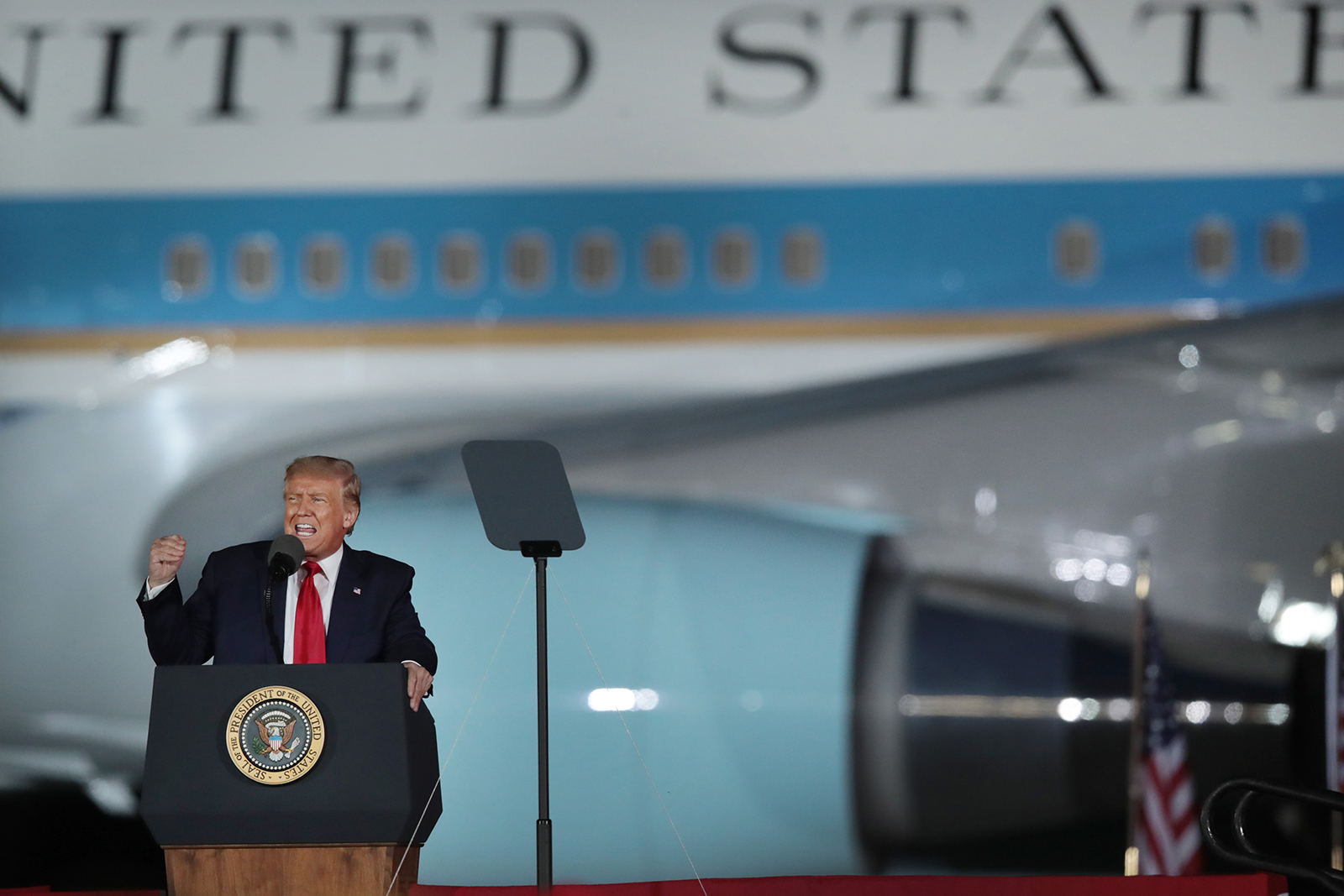 President Donald Trump speaks to supporters at a rally with Air Force One in the background in Freeland, Michigan, on September 10.