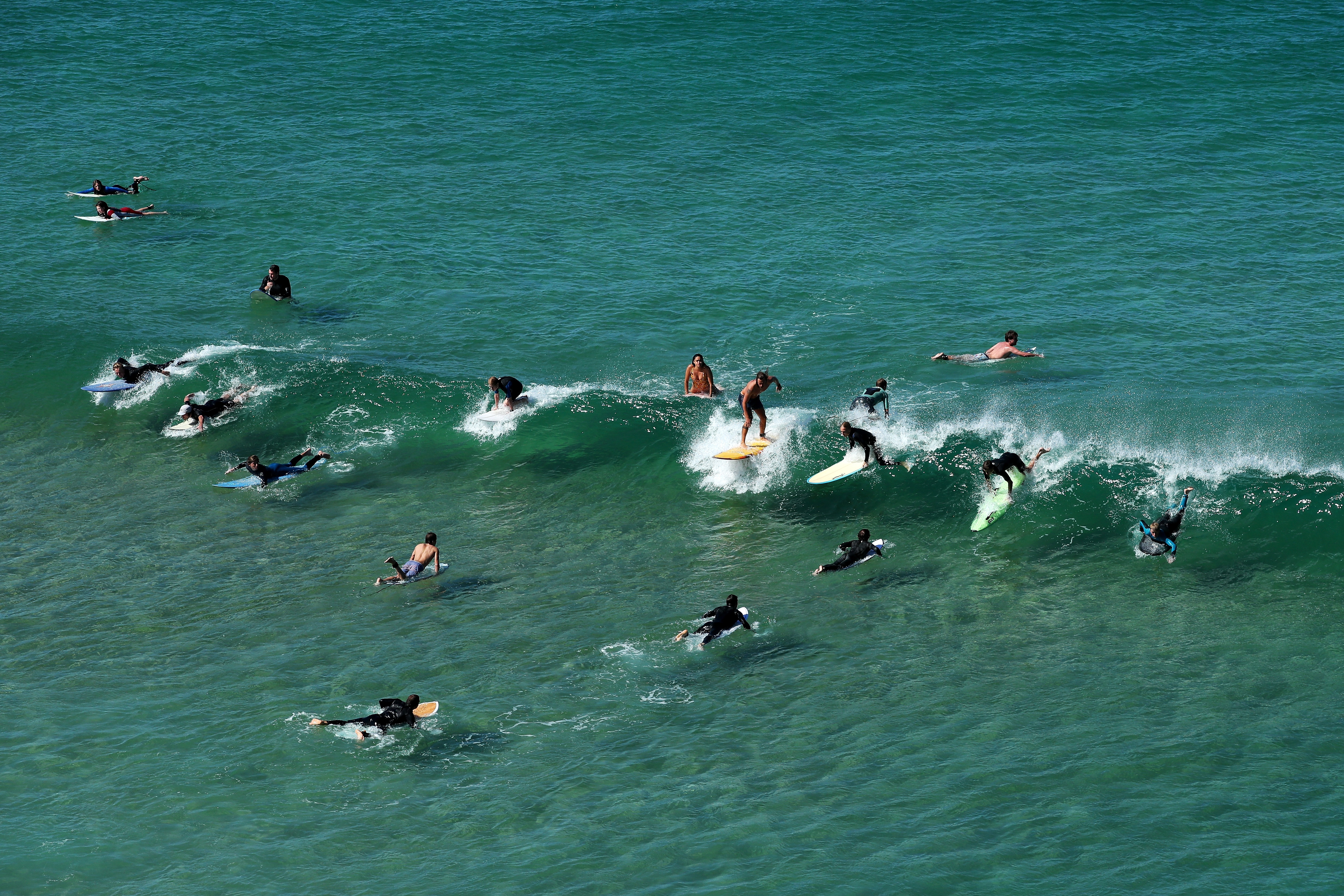 Surfers ride waves at Freshwater Beach in Sydney on on April 5.