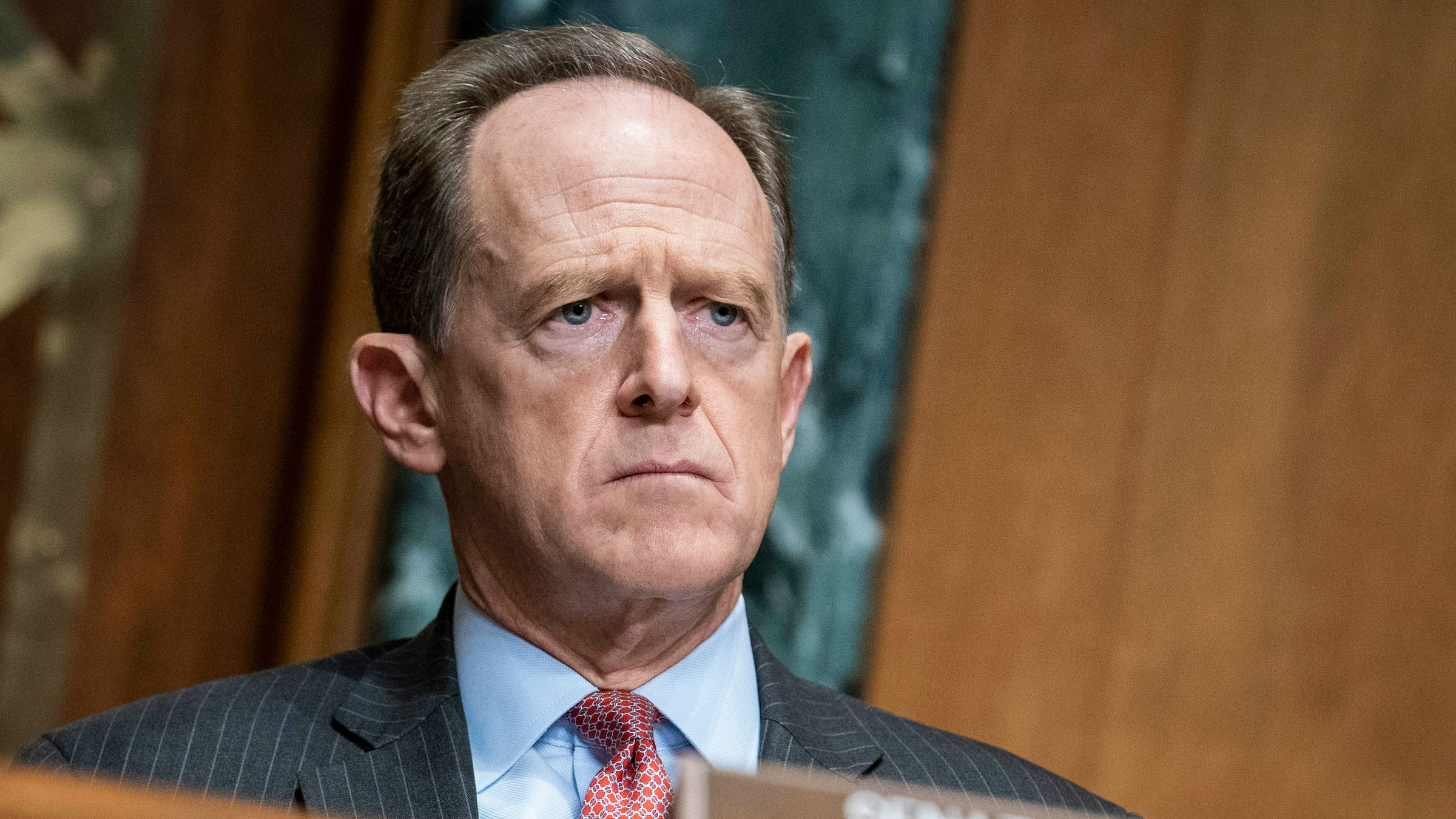US Sen. Pat Toomey attends a Capitol Hill hearing on December 10.