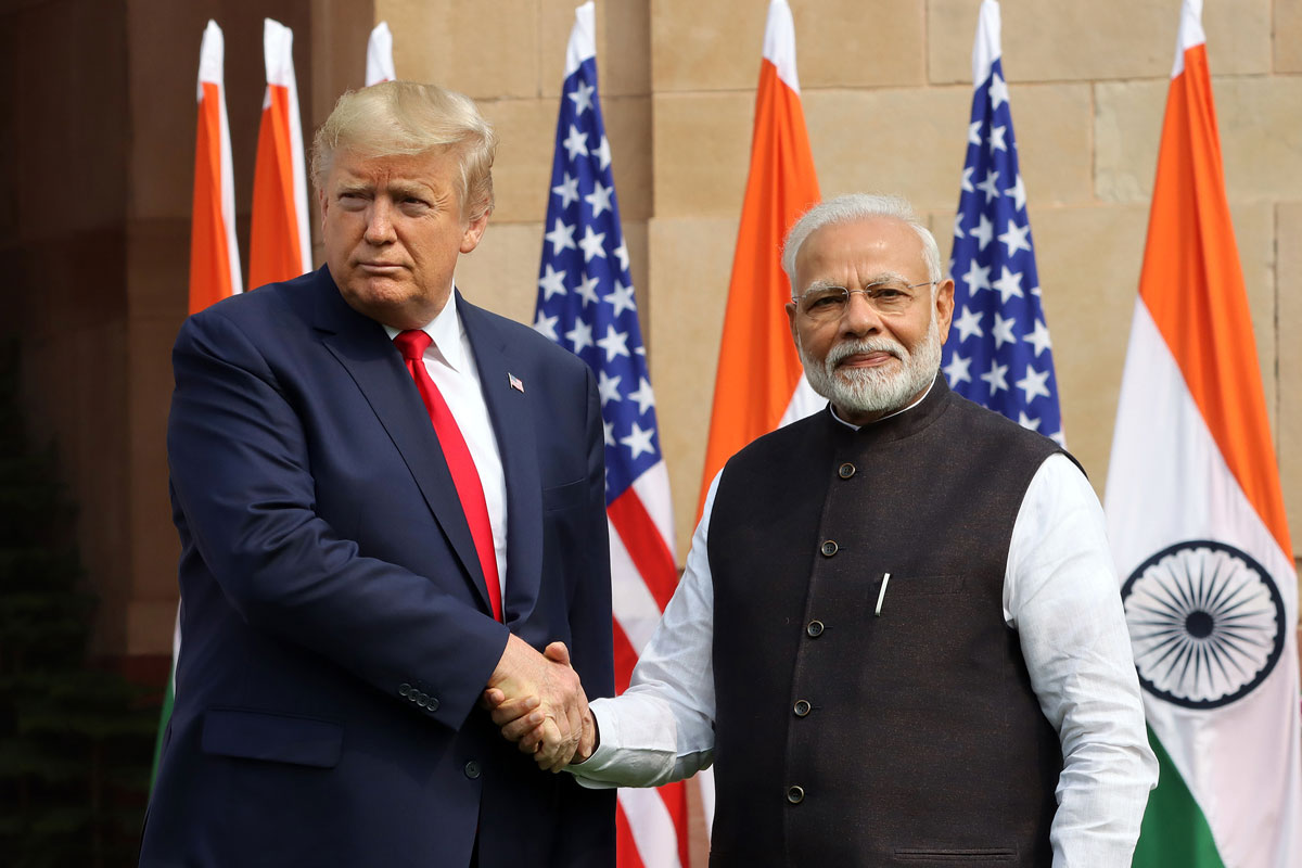 US President Donald Trump shakes hand with Narendra Modi, India's prime minister, as they pose for photographers at Hyderabad House in New Delhi on Tuesday, February 25.