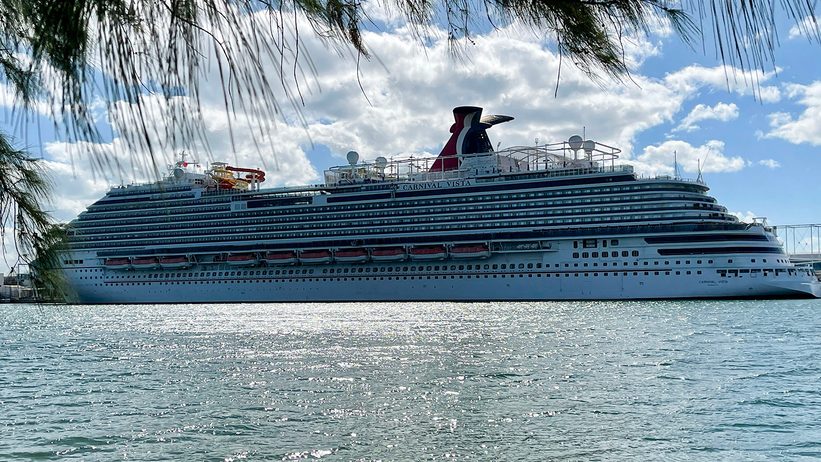 """The cruise ship """"Carnival Vista"""" part of the Carnival Cruise Line, is seen moored at a quay in the port of Miami, Florida, on December 23, 2020."""