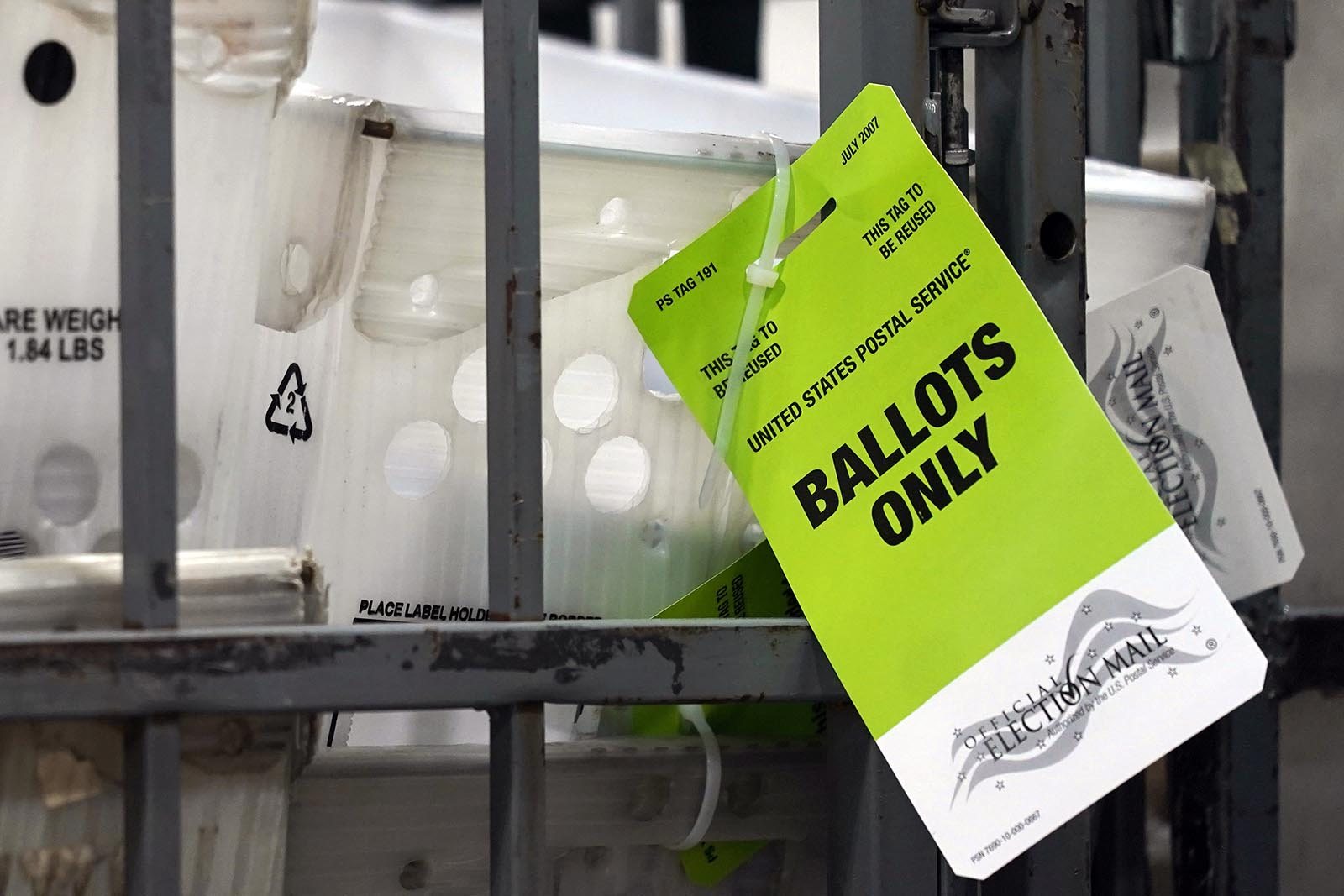 Vote-by-mail ballots sit ready for transport to a local U.S. Postal Service office at the Broward Supervisor of Elections Office, on Thursday, September 24, in Lauderhill, Florida.