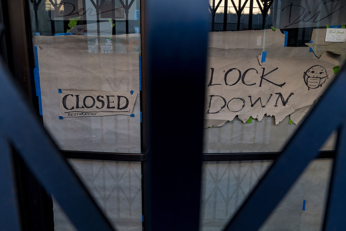 """A """"closed"""" sign on the door of a business in San Francisco, California on December 7."""