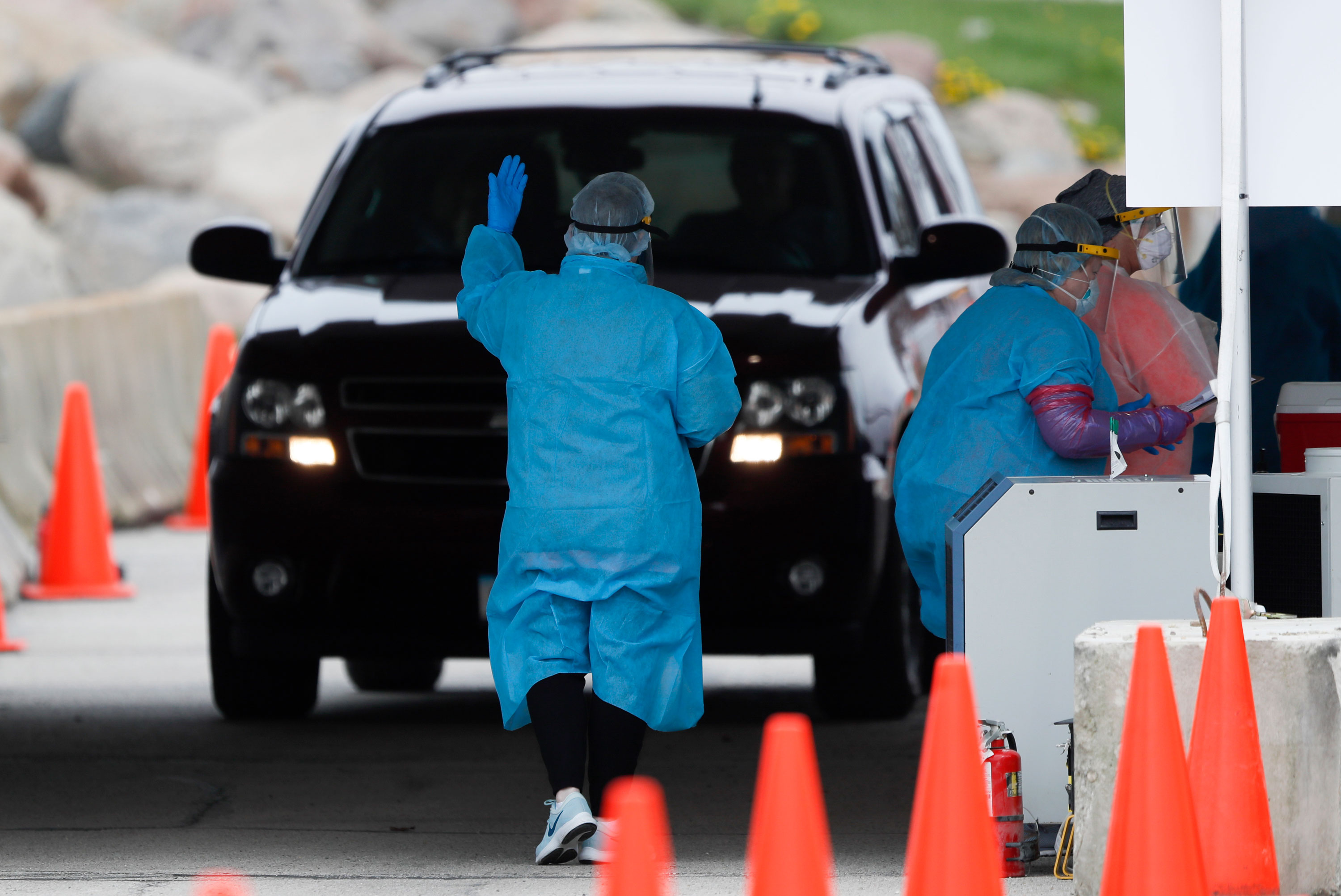 A medical worker directs a local resident at a drive-thru COVID-19 testing site in Waterloo, Iowa, on May 1.