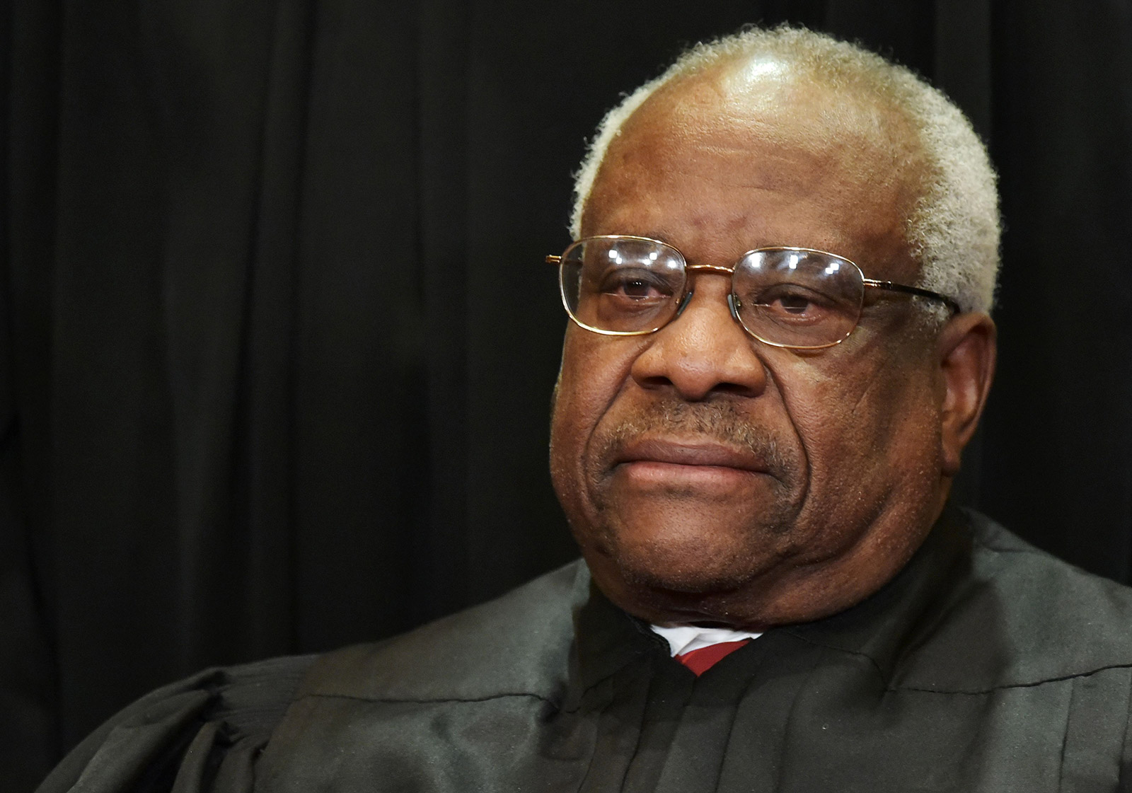 Justice Clarence Thomas poses for the official Supreme Court group photo in 2018.