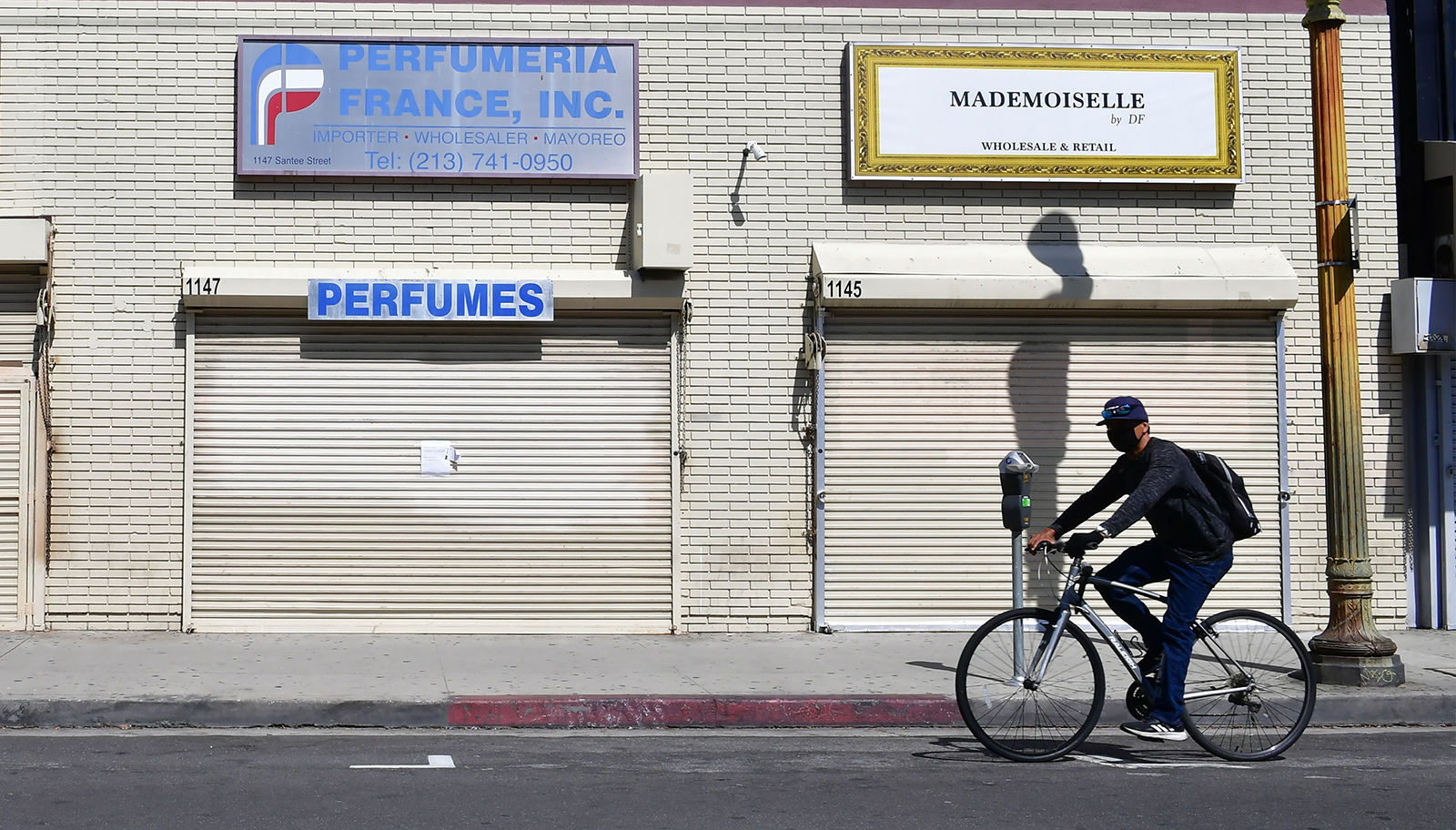 Closed shopfronts in what would be a normally busy fashion district in Los Angeles, California on May 4.