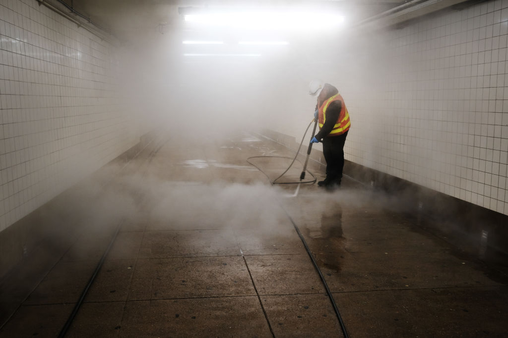Workers clean a subway station in New York City on Wednesday.
