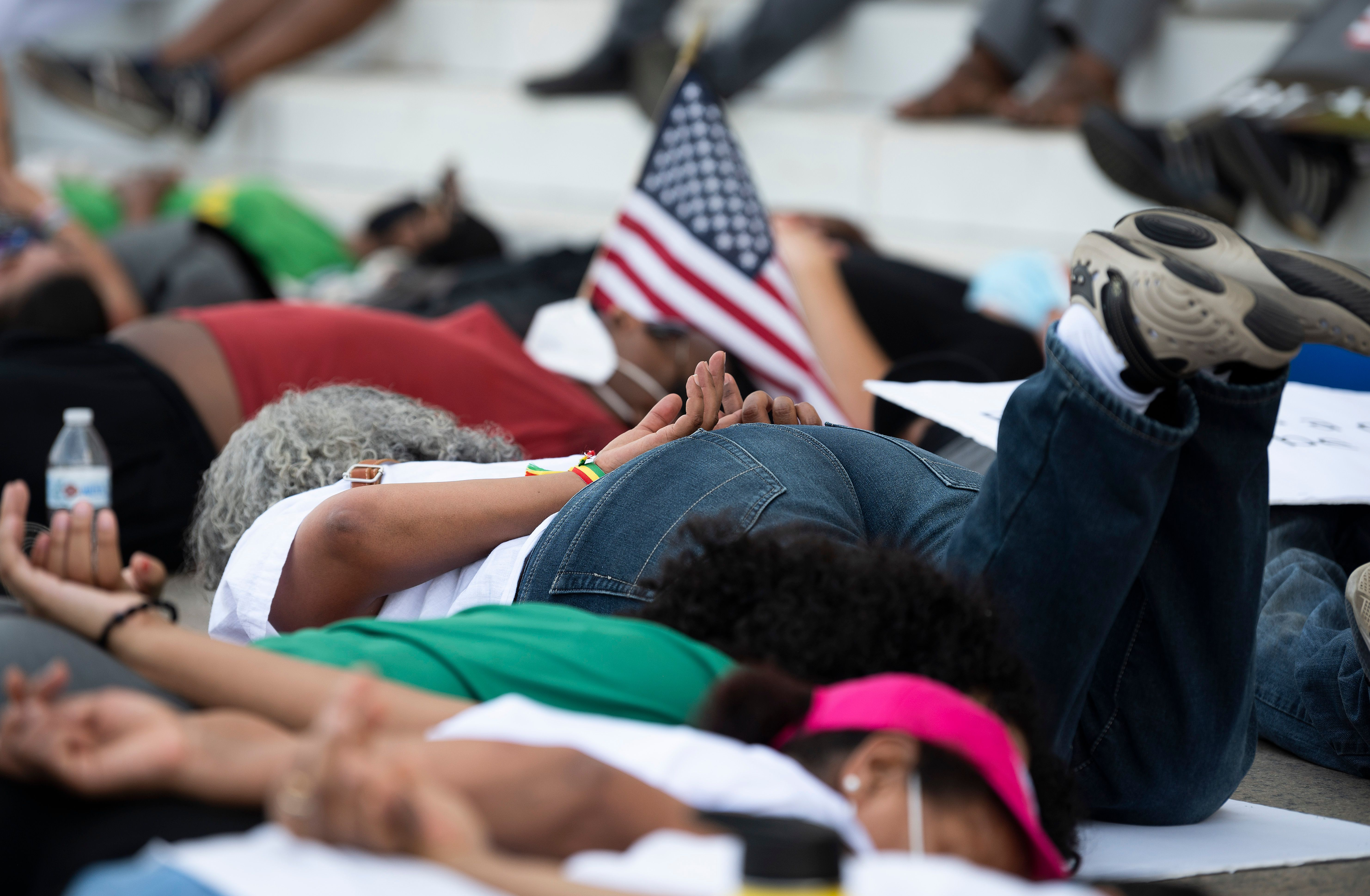 Protesters demonstrate the death of George Floyd at the Lincoln Memorial on June 9 in Washington, DC.