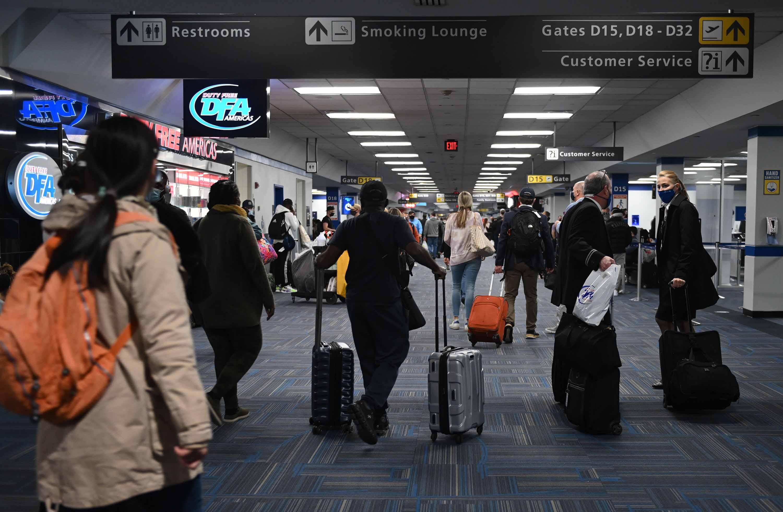 Passengers walk through a terminal at Dulles International airport in Virginia on Sunday, December 27.