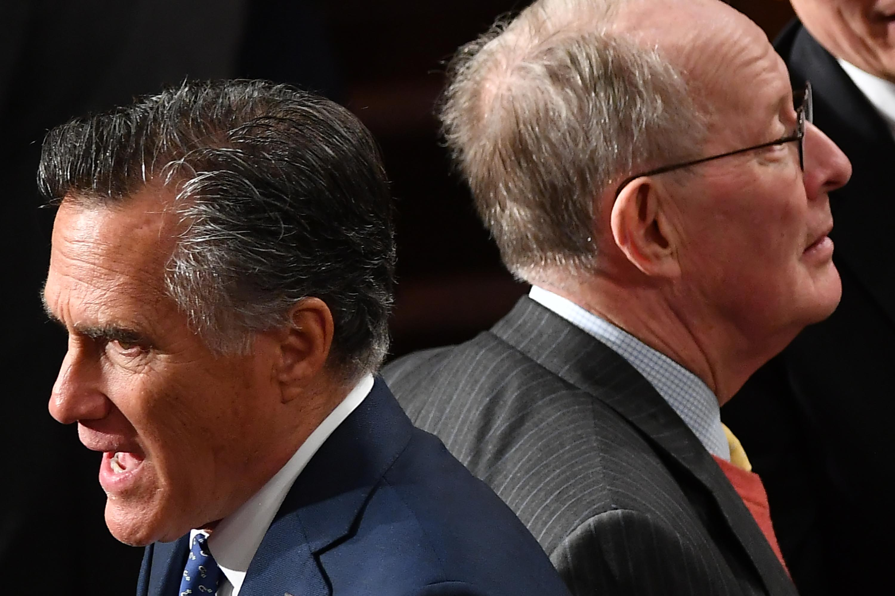 Sen. Mitt Romney and Sen. Lamar Alexander cross paths before the start of the State Of The Union address on Tuesday.