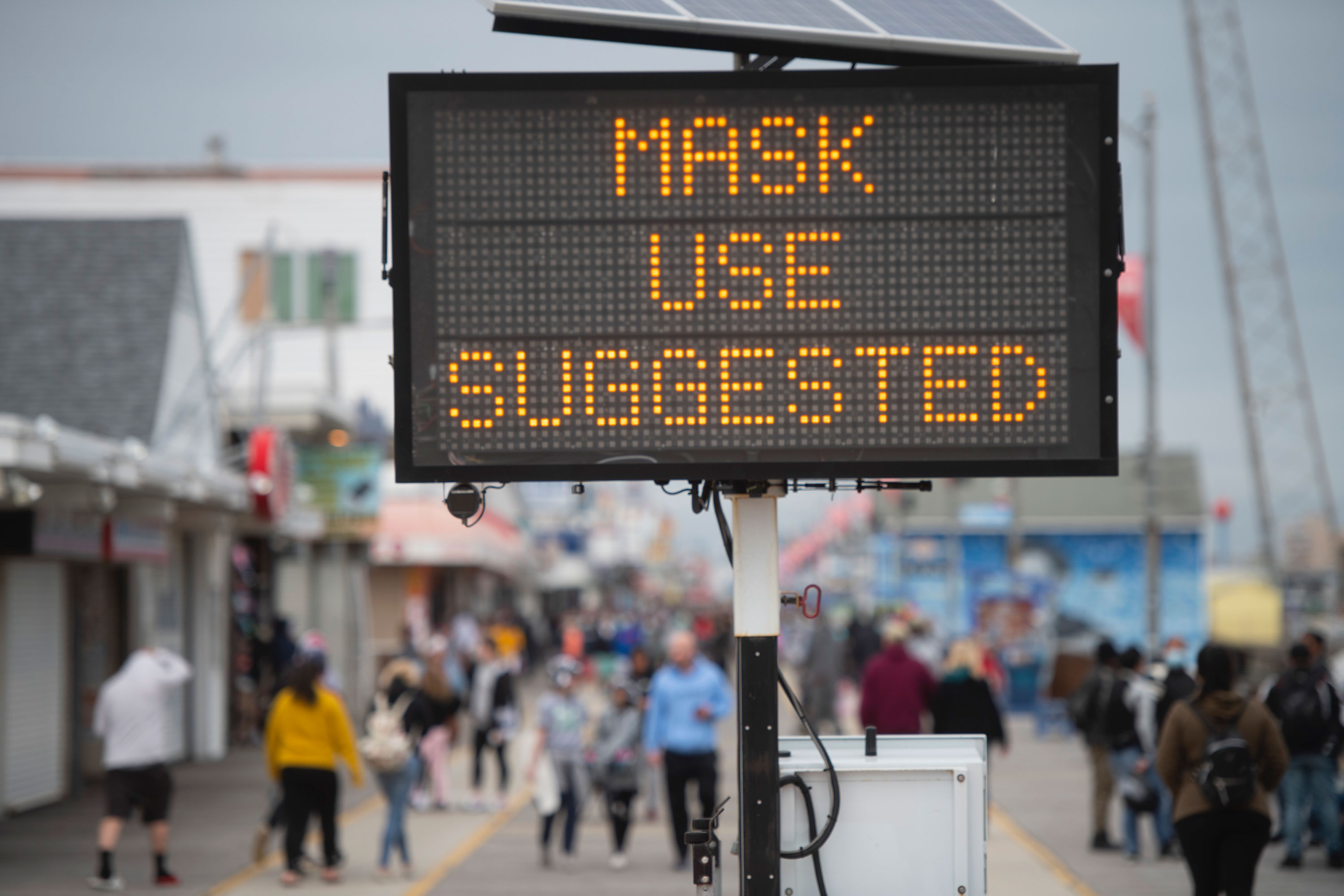 A sign on a boardwalk in Wildwood, New Jersey, on May 24, suggesting visitors wear masks.