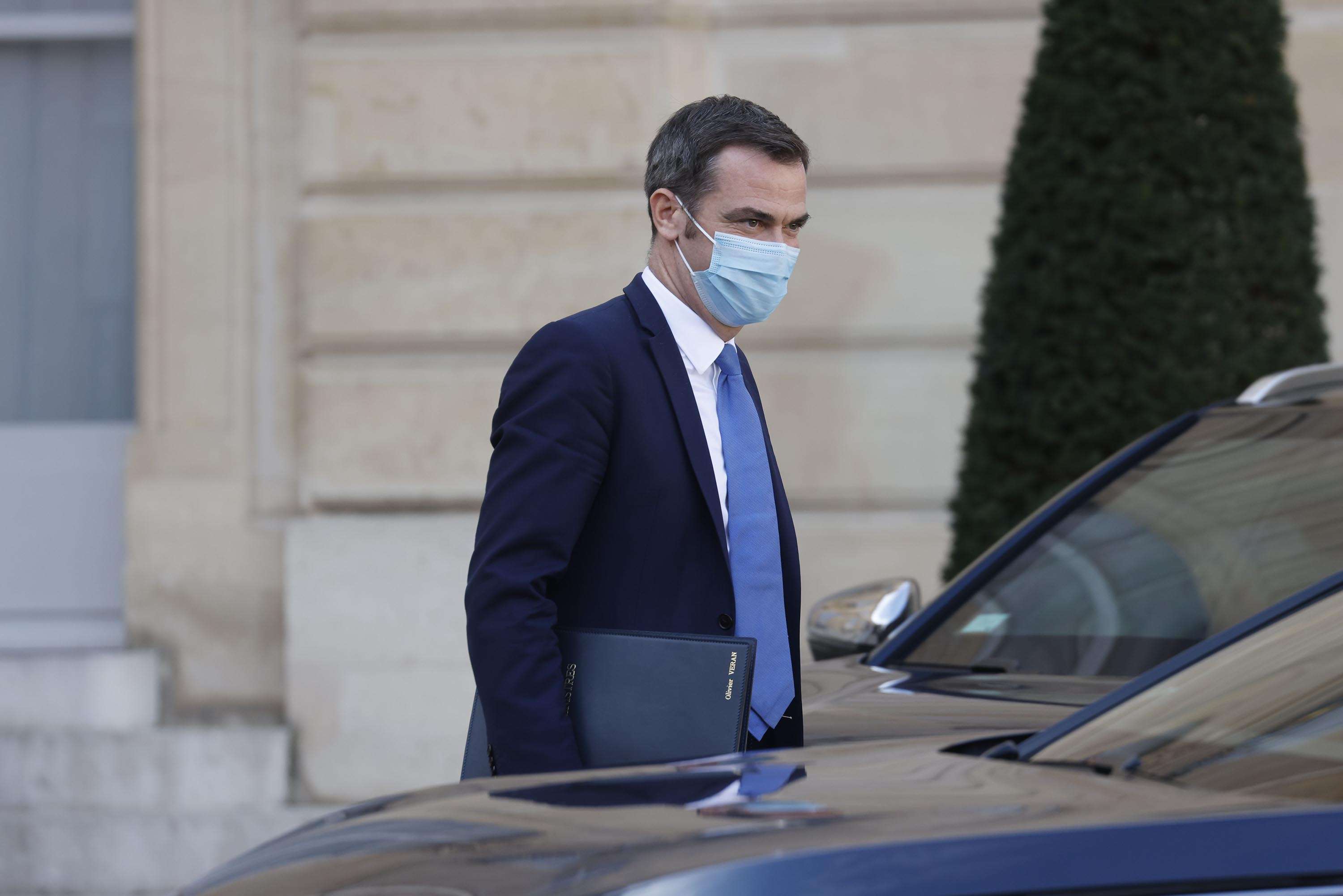 French Health Minister Olivier Veran is pictured leaving a weekly cabinet meeting at the Elysee Palace in Paris, on October 14.