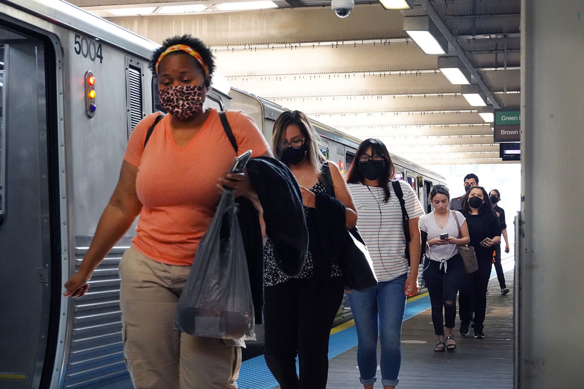 Commuters travel on Chicago's L train system on July 27.