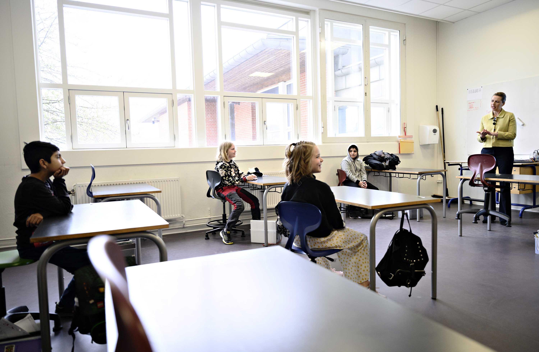 Denmark's Prime Minister Mette Frederiksen, right, speaks to pupils during the reopening of Lykkebo School in Copenhagen, on April 1.