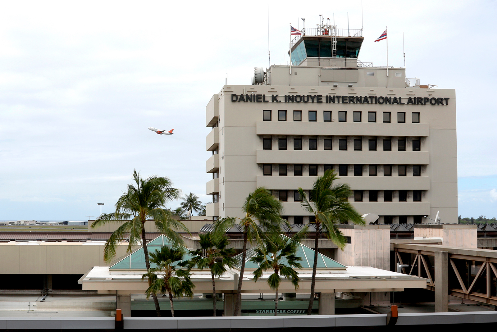A plane takes off over the international airport in Honolulu on April 21.