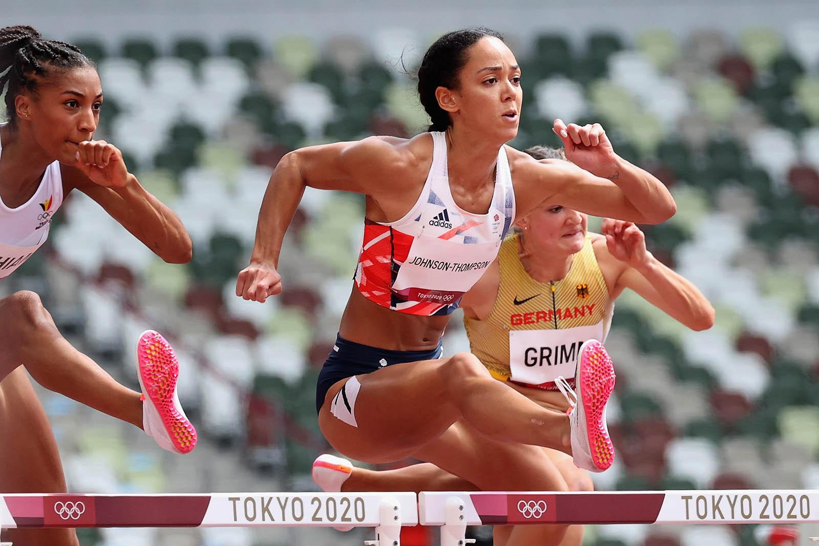 Johnson-Thompson, center, competes in the women's heptathlon 100m hurdles on Wednesday.