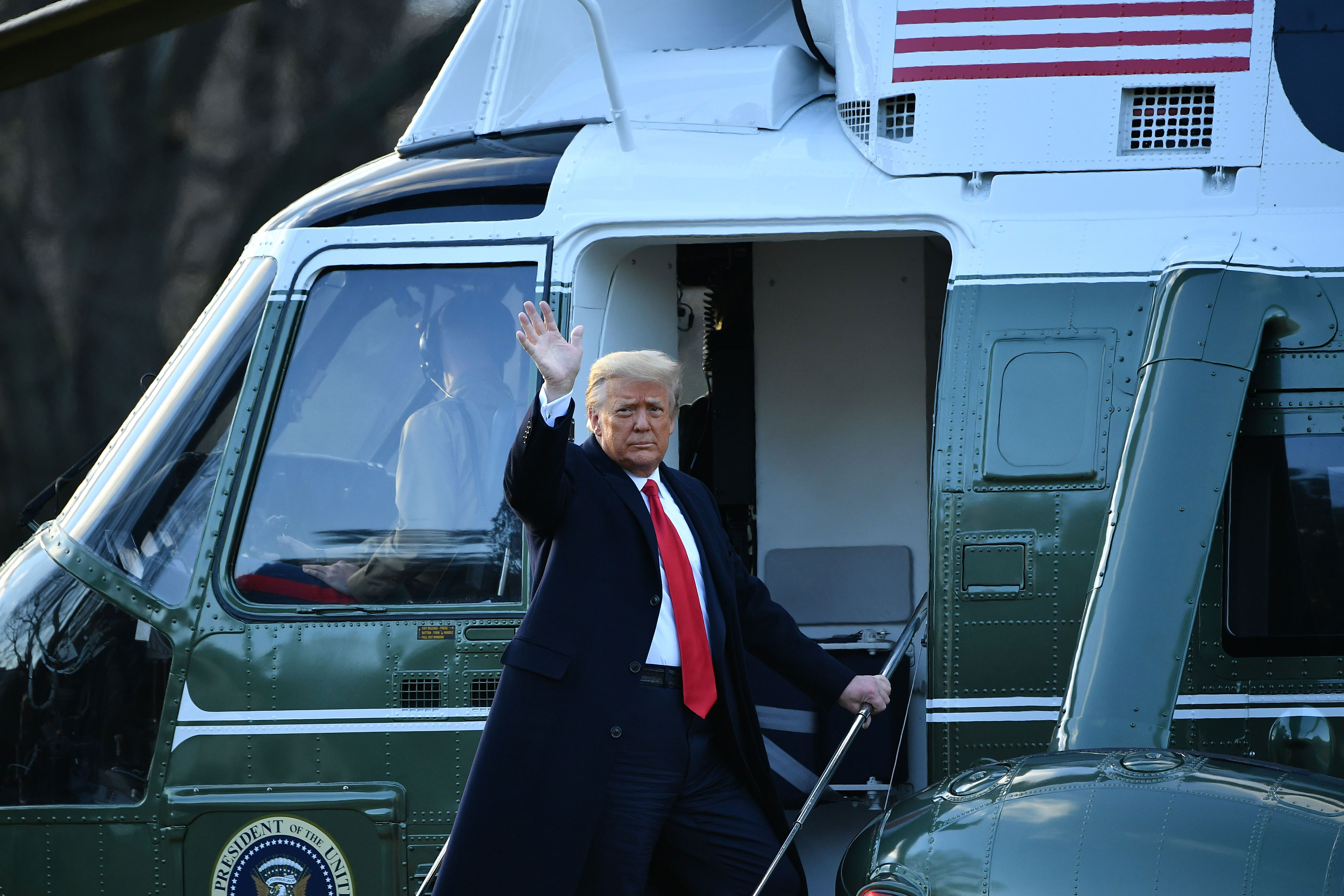 President Donald Trump waves as he boards Marine One at the White House on January 20.