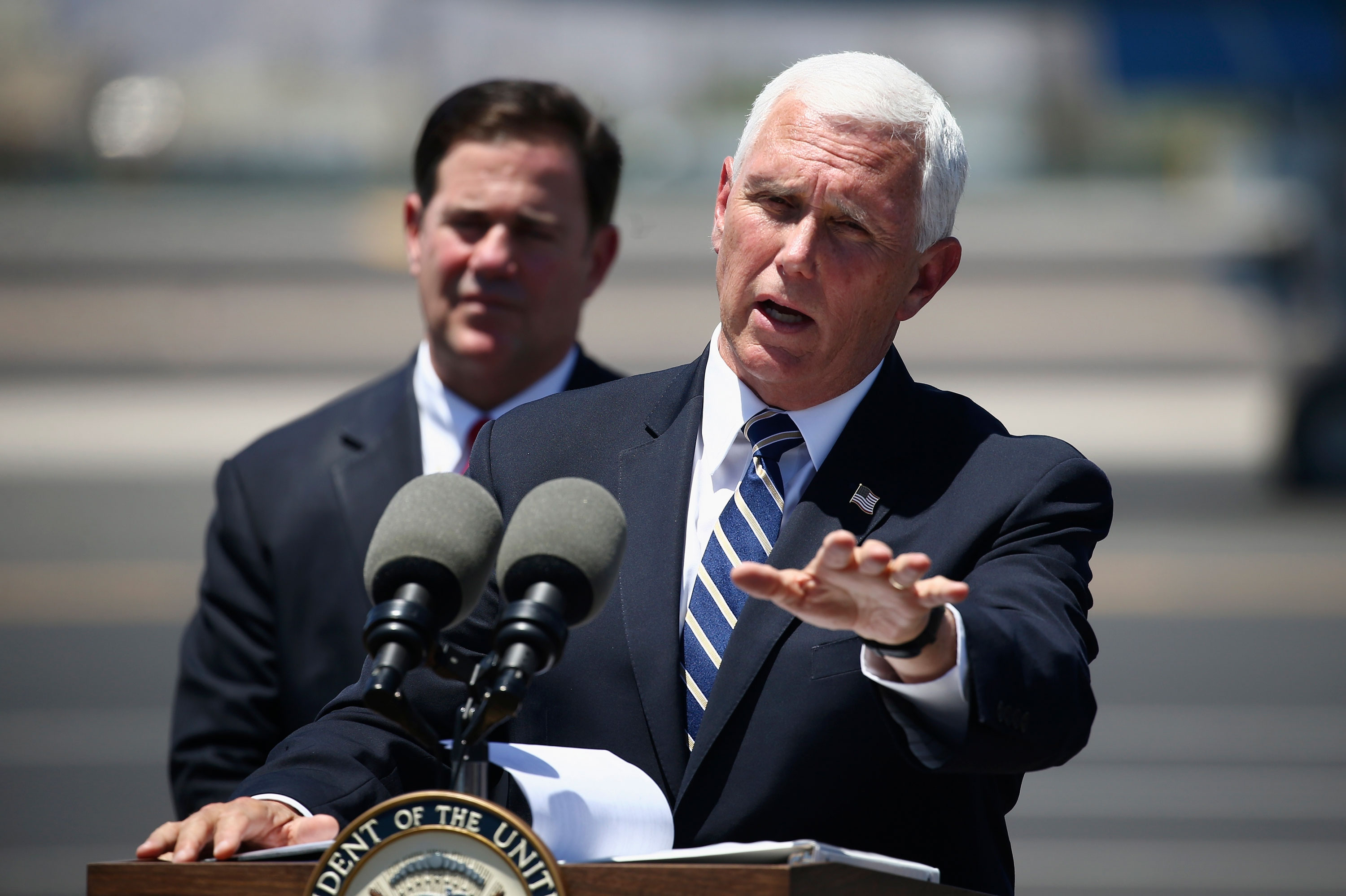 Vice President Mike Pence answers a question as he holds a news conference in Phoenix on July 1.
