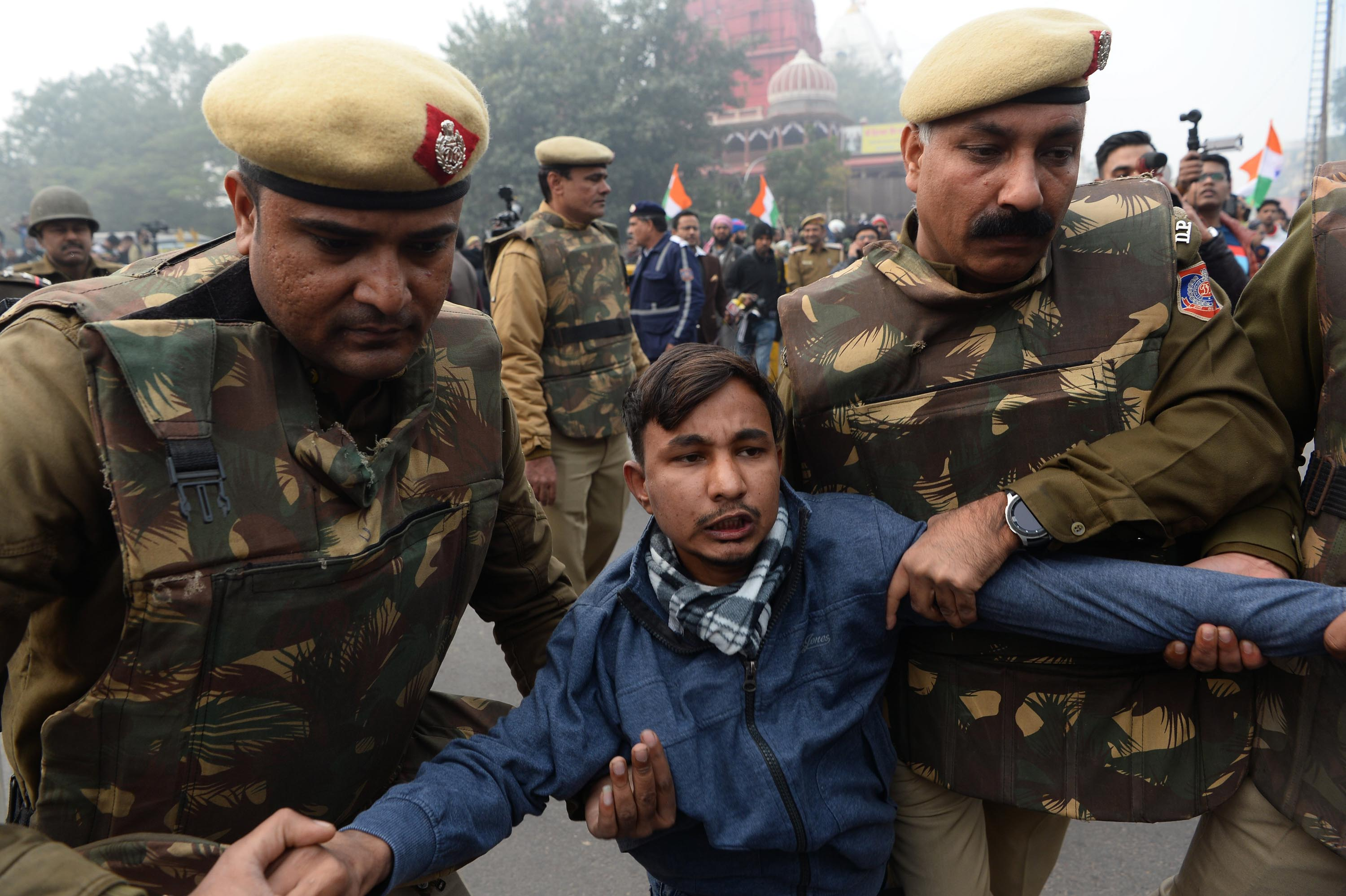 Police detain a protester at a demonstration in New Delhi on Thursday. Photo: Sajjad Hussain/AFP via Getty Images