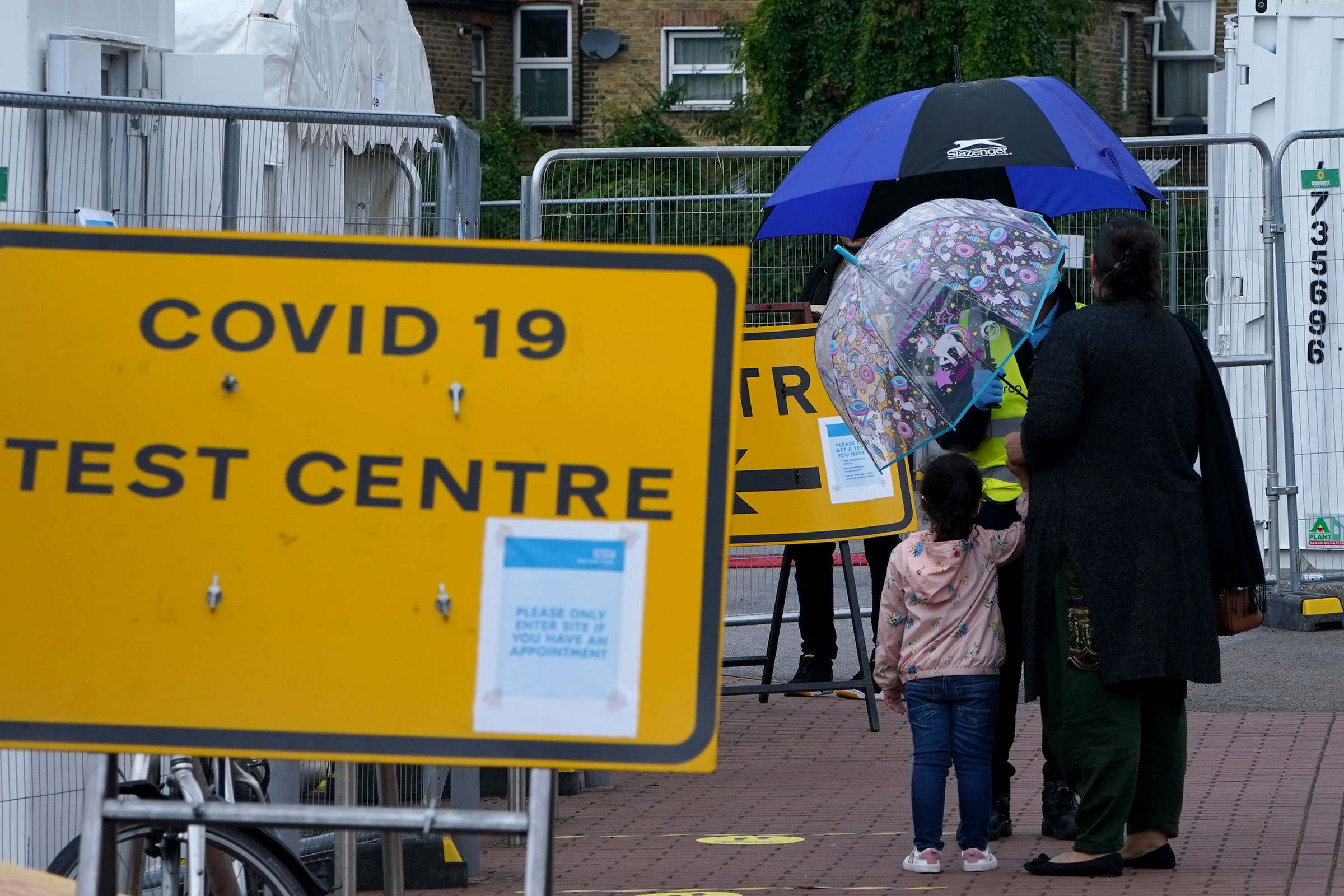 People wait outside a Covid-19 testing center in Walthamstow on September 23, in London, England.