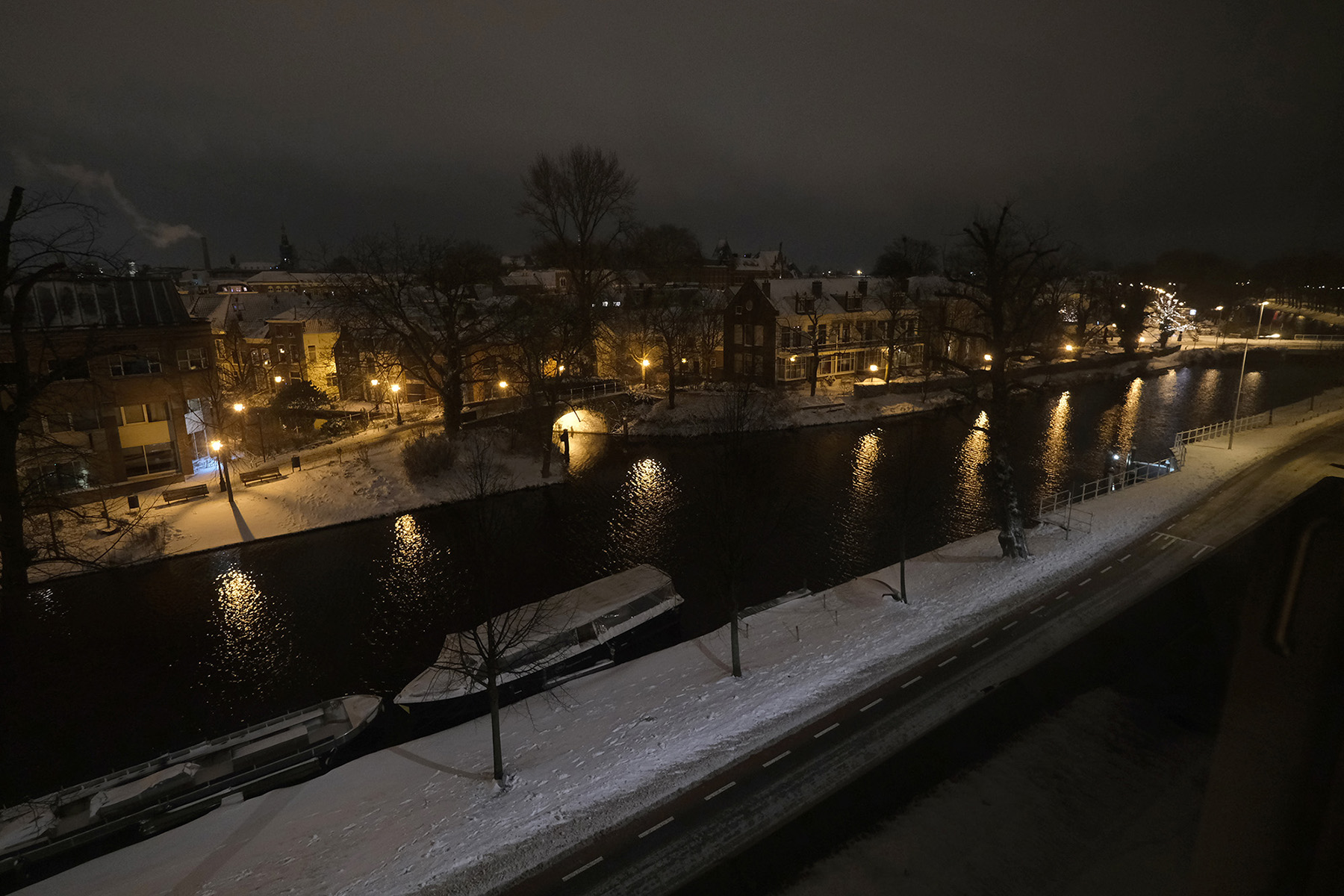 A snowy canal scene during a night curfew on February 7, 2021, in Leiden, Netherlands.