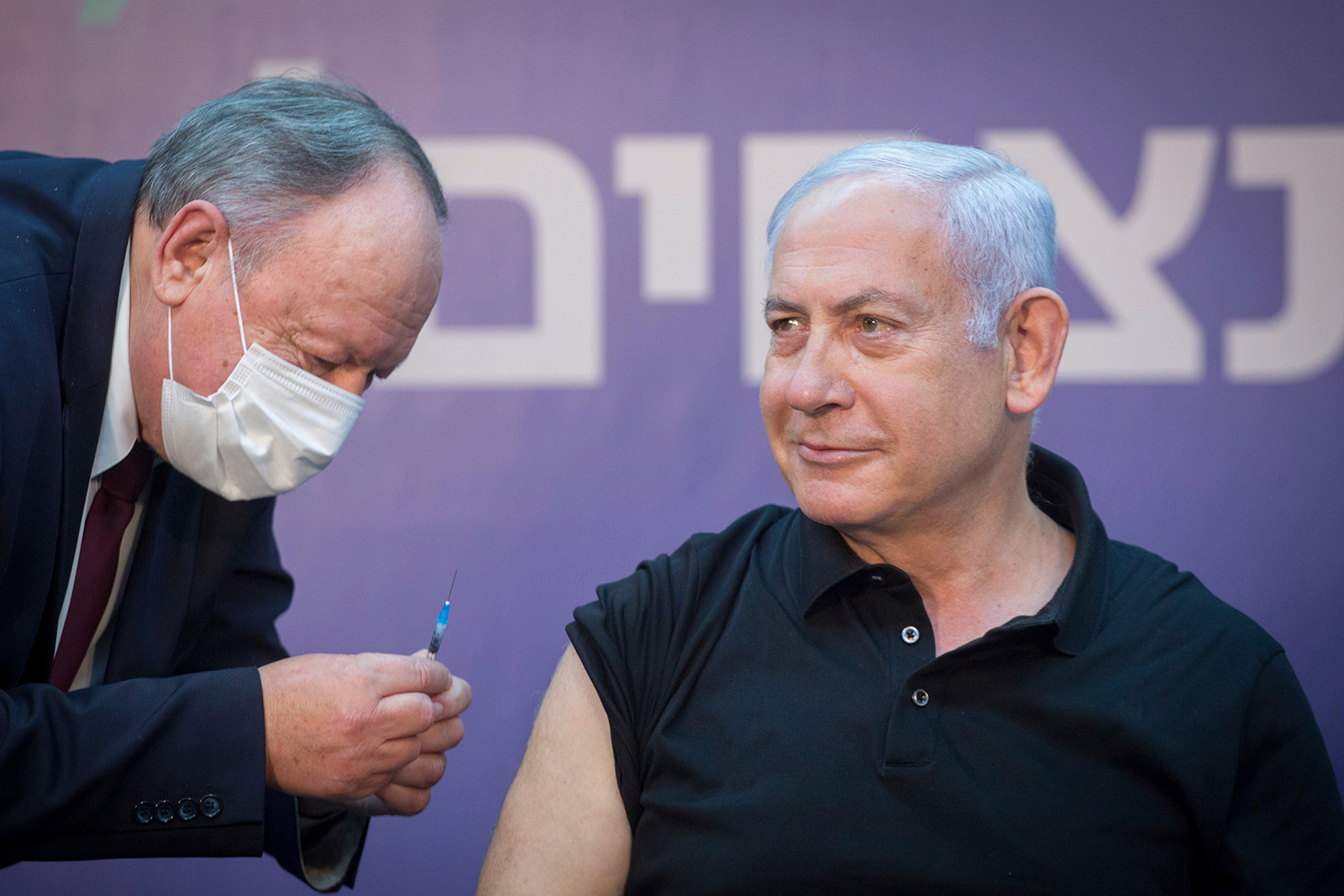 Israeli Prime Minister Minister Benjamin Netanyahu is ready to receive the second Covid-19 vaccine at Sheba Medical Center in Ramat Gan, Israel, on January 9.